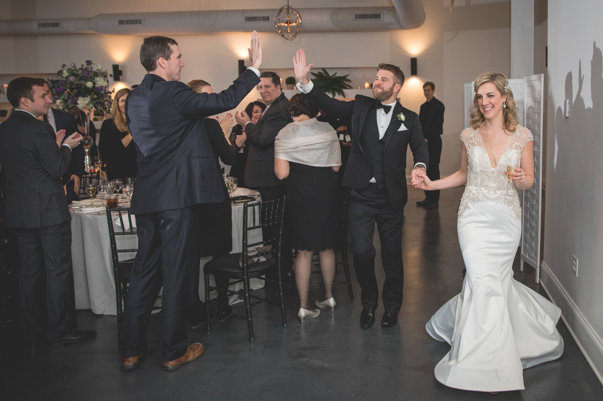 high-five-bride-and-groom.jpg