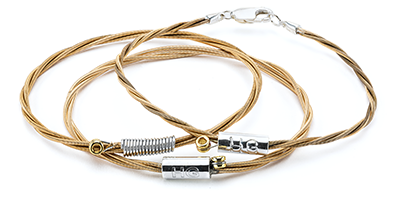 Country music superstar's Willie Nelson guitar string bracelets with proceeds going to Farm Aid.