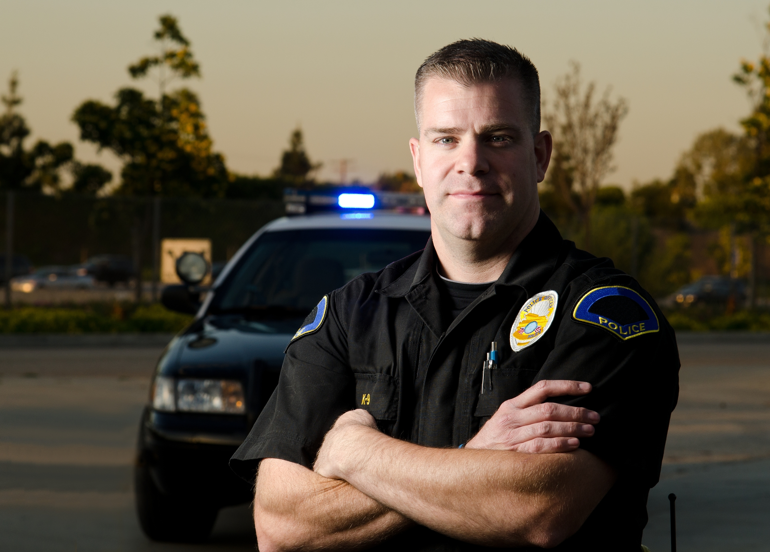 shutterstock_police officer with arms folded.jpg