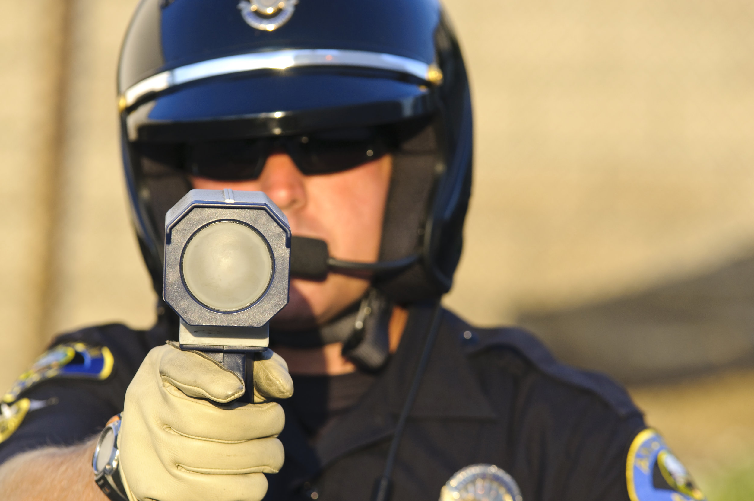 shutterstock_cop pointing radar gun.jpg