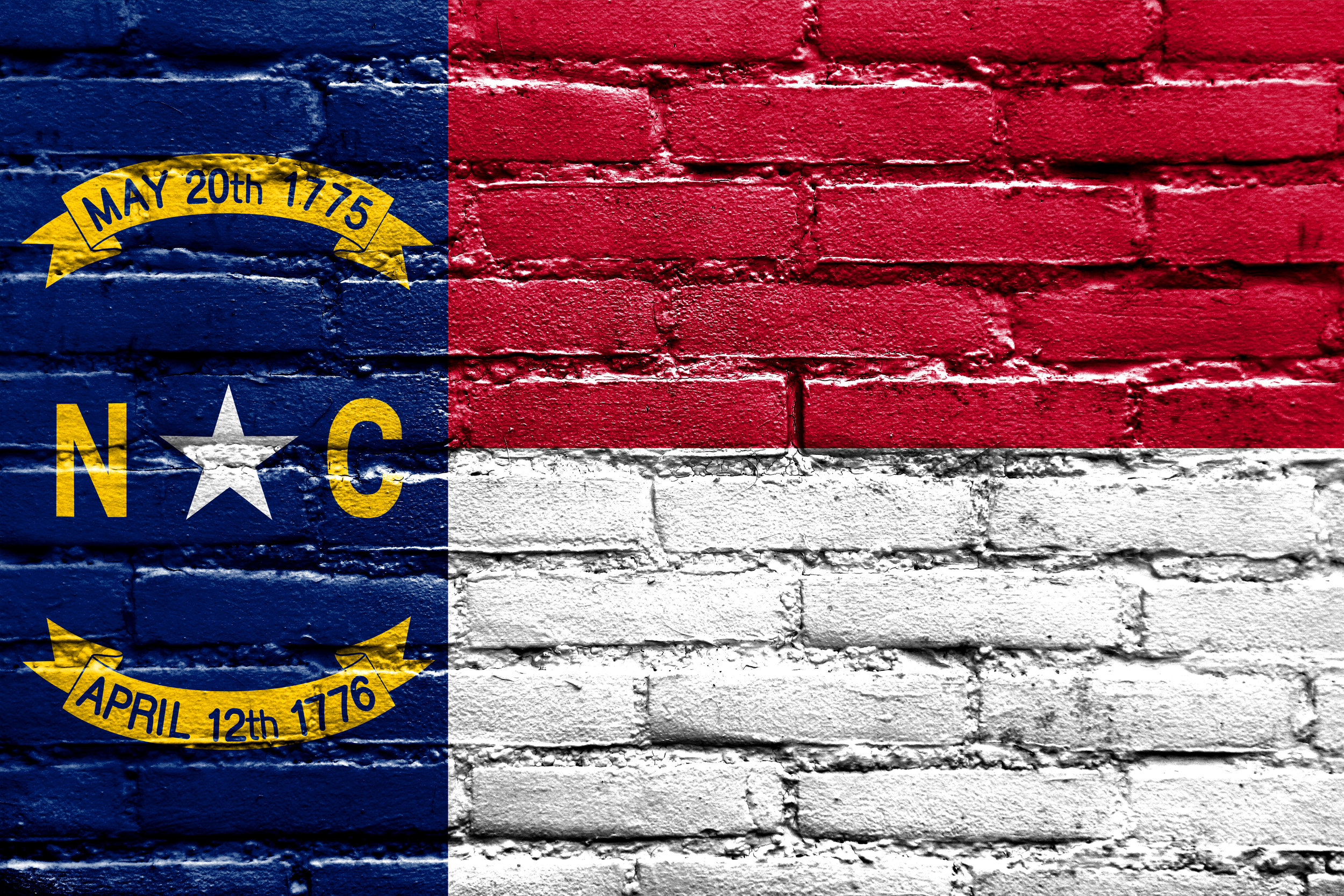 shutterstock_north carolina flag on brick.jpg