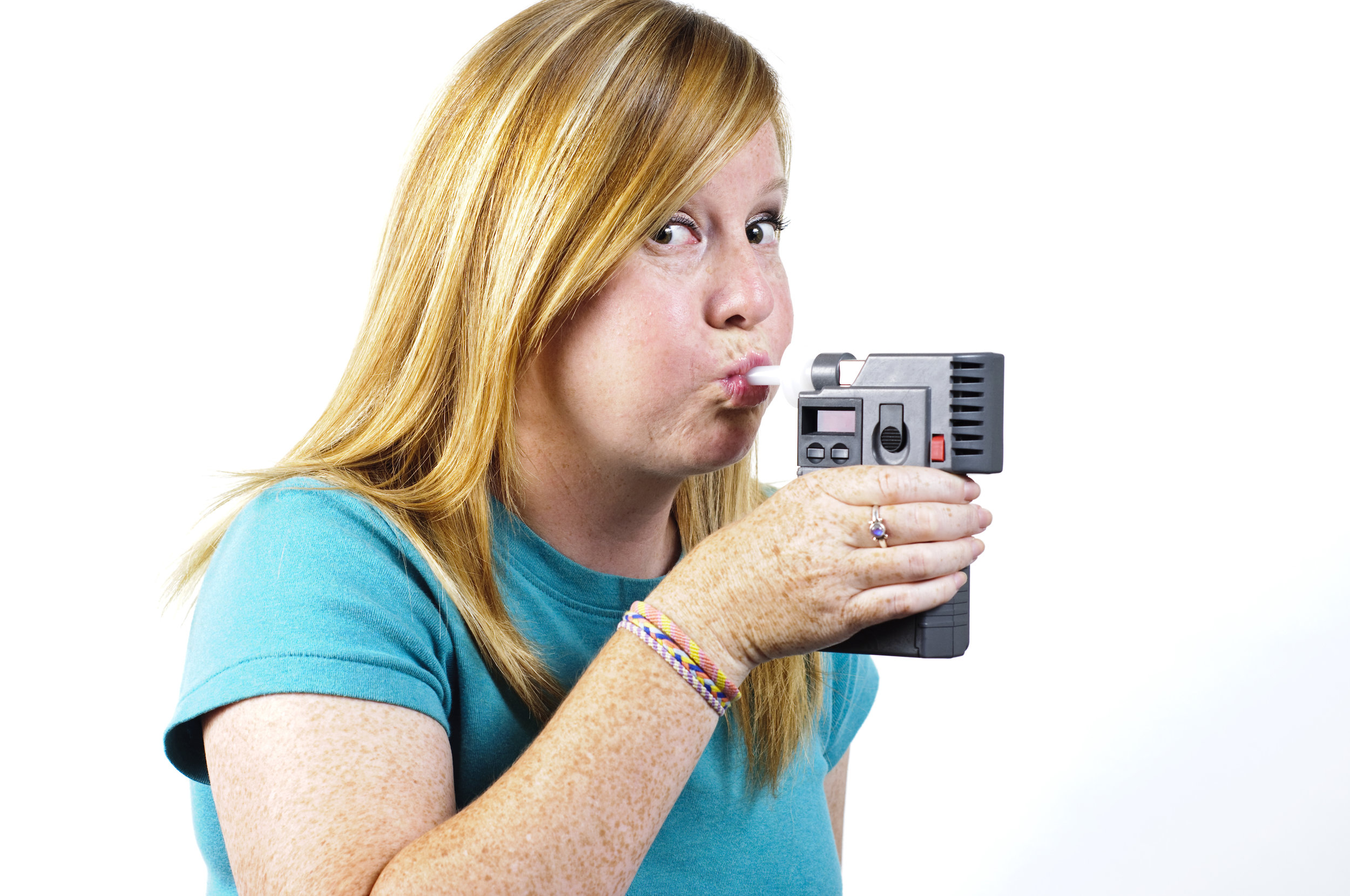 shutterstock_woman blowing into breathalyzer.jpg