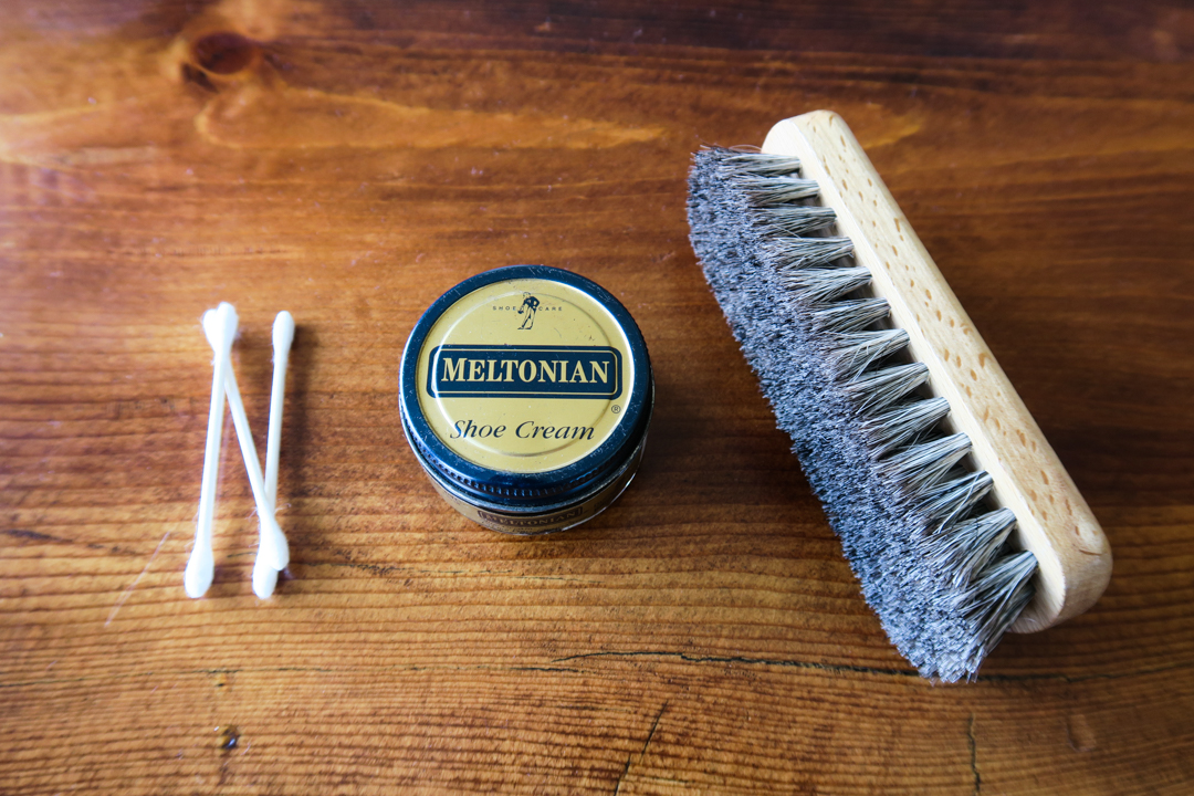 Things you will need: Q Tips; Shoe Cream; and a Shoe Brush.  You can purchase a shoe brush online or at a shoe repair store. Remember to wear something that you do not mind getting shoe cream on. It can get messy.