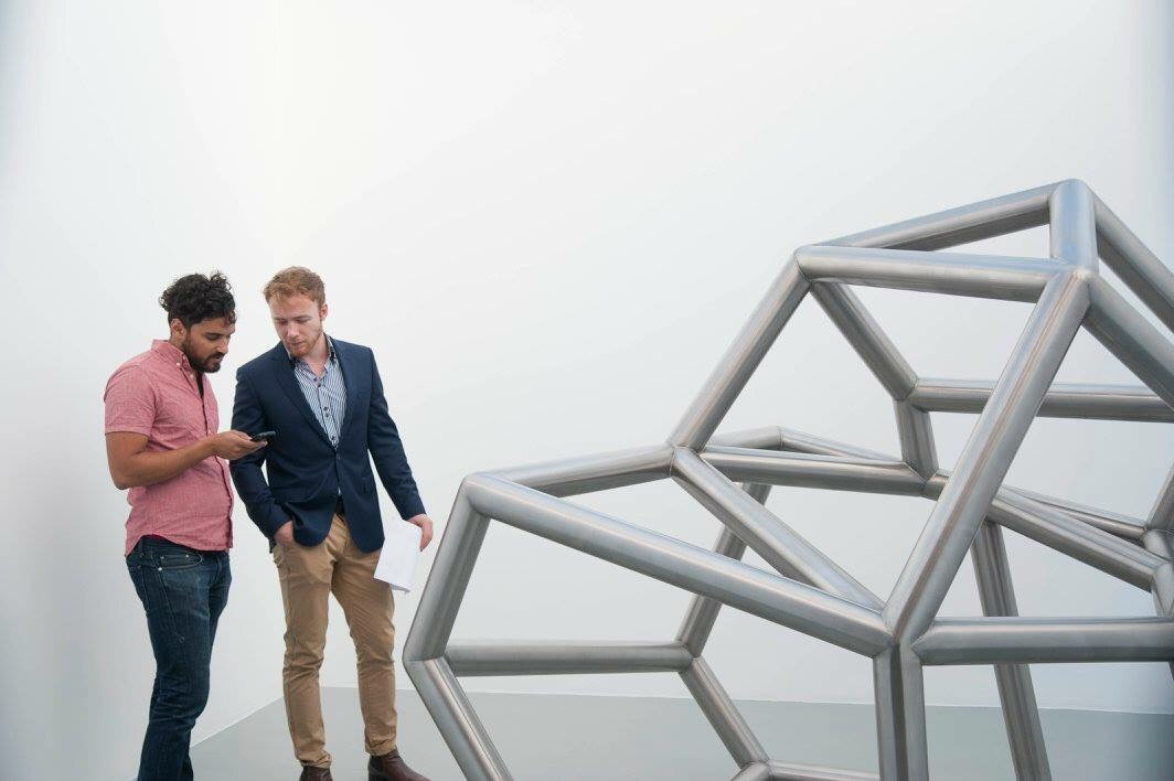 Johan and I discussing a Modernist sculpture Siamese Metal #6 by Richard Deacon