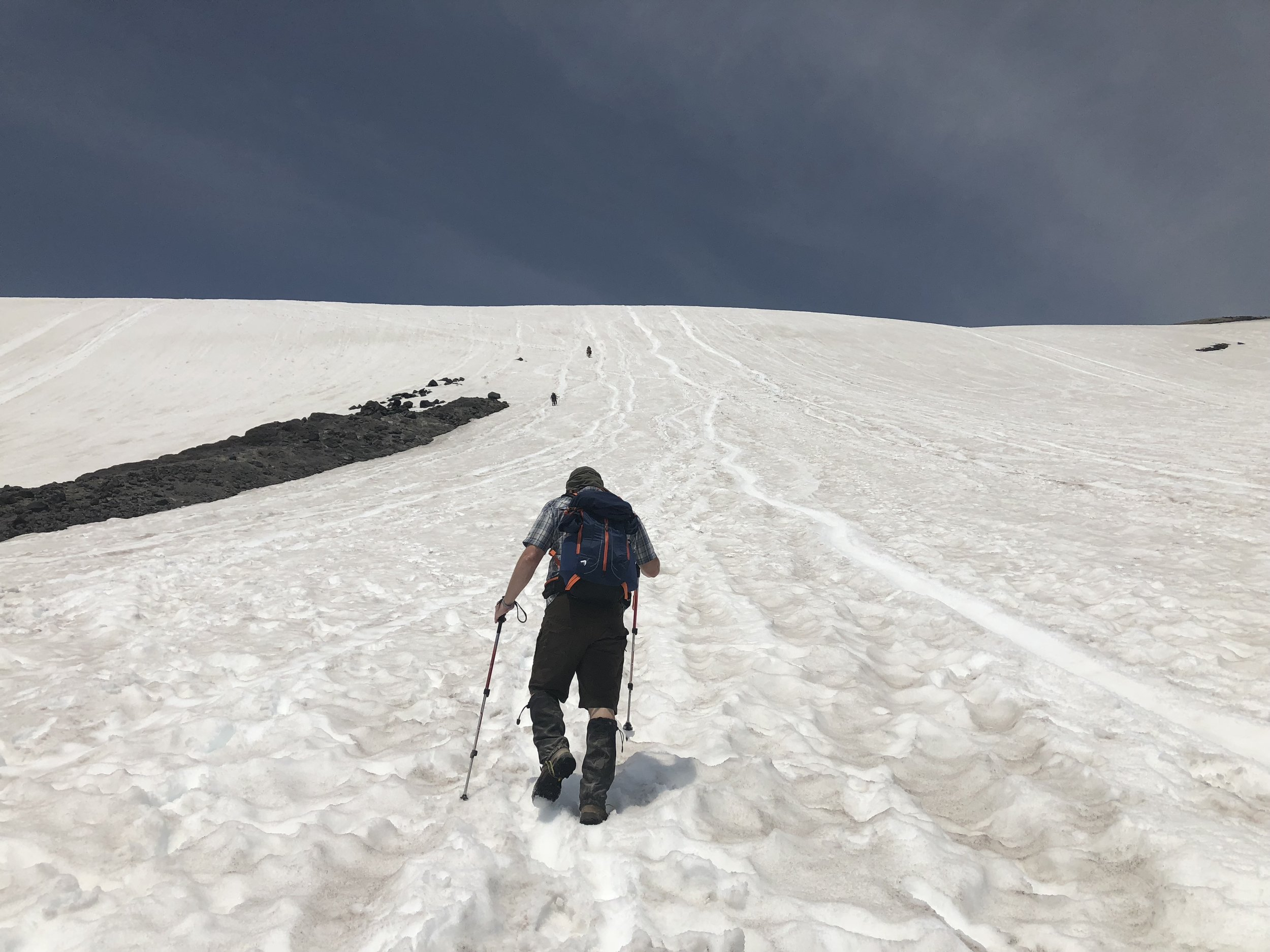 Climbing up to join the Monitor Ridge trail next to glissade paths.