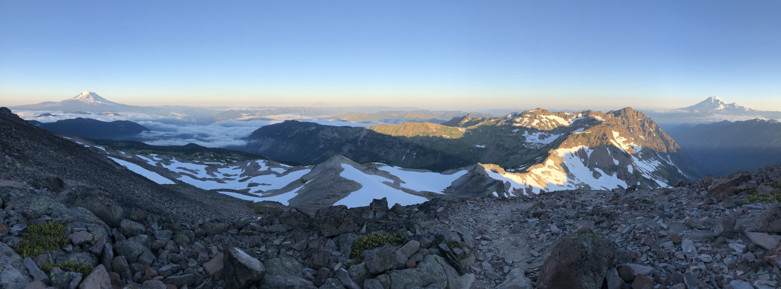 Early morning over Cascadia with Mount Adams on the left, Mount St. Helens in the middle, and Mount Rainier on the right.