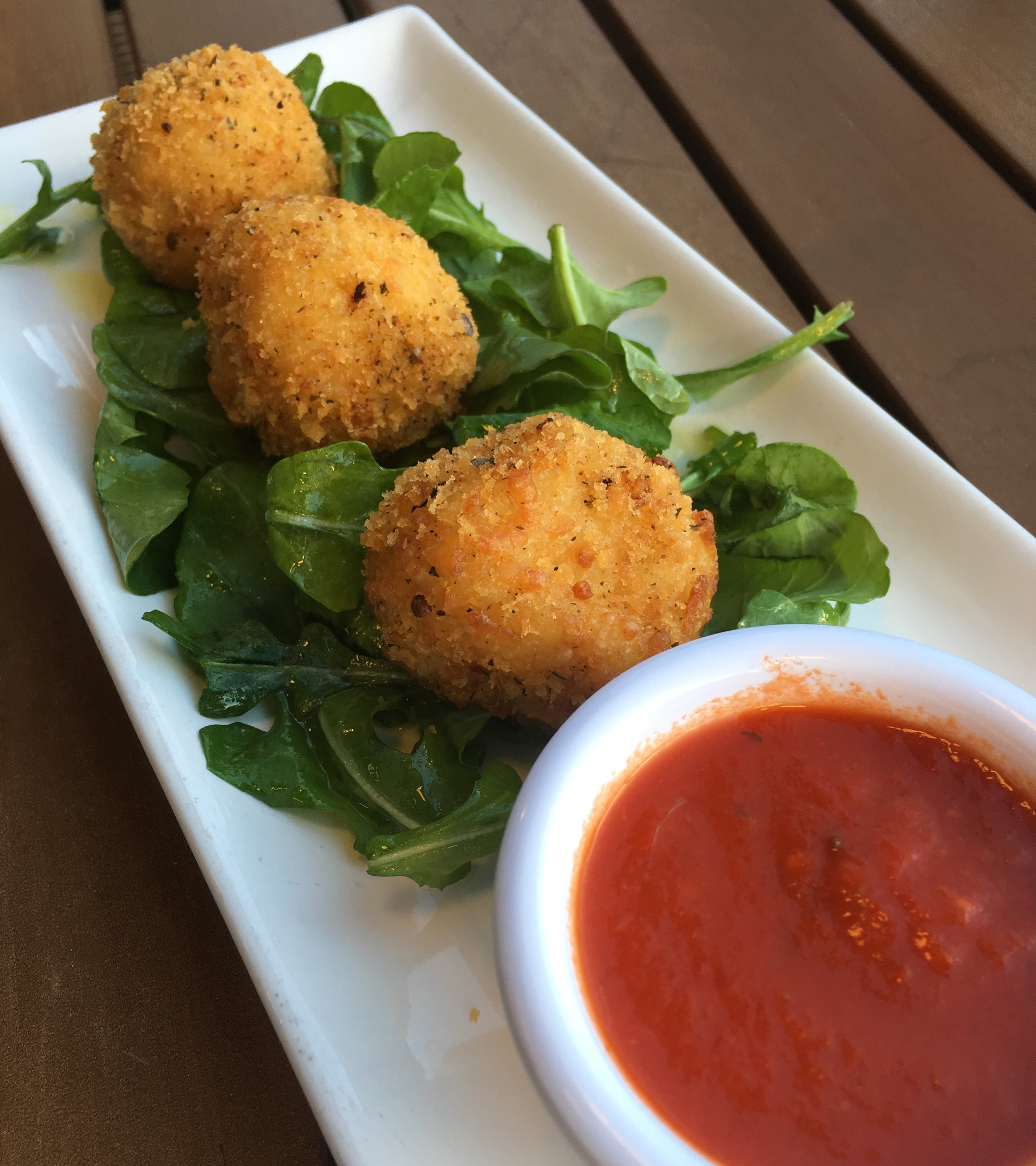 Dinner Appetizer One: Arancini with marinara sauce.
