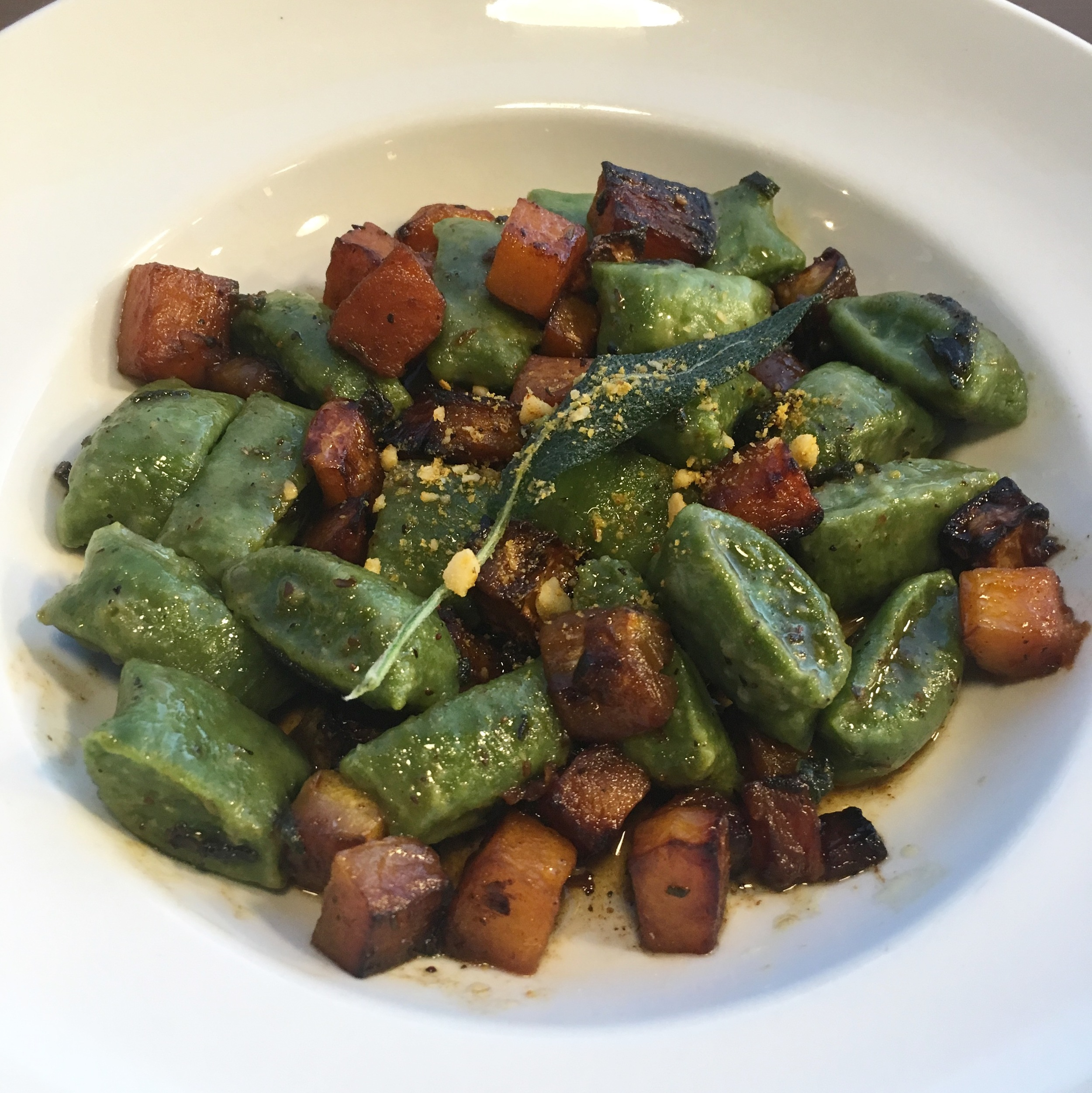 Dinner Entree One: Spinach rictotta gnocchi  with a butternut squash sage sauce.