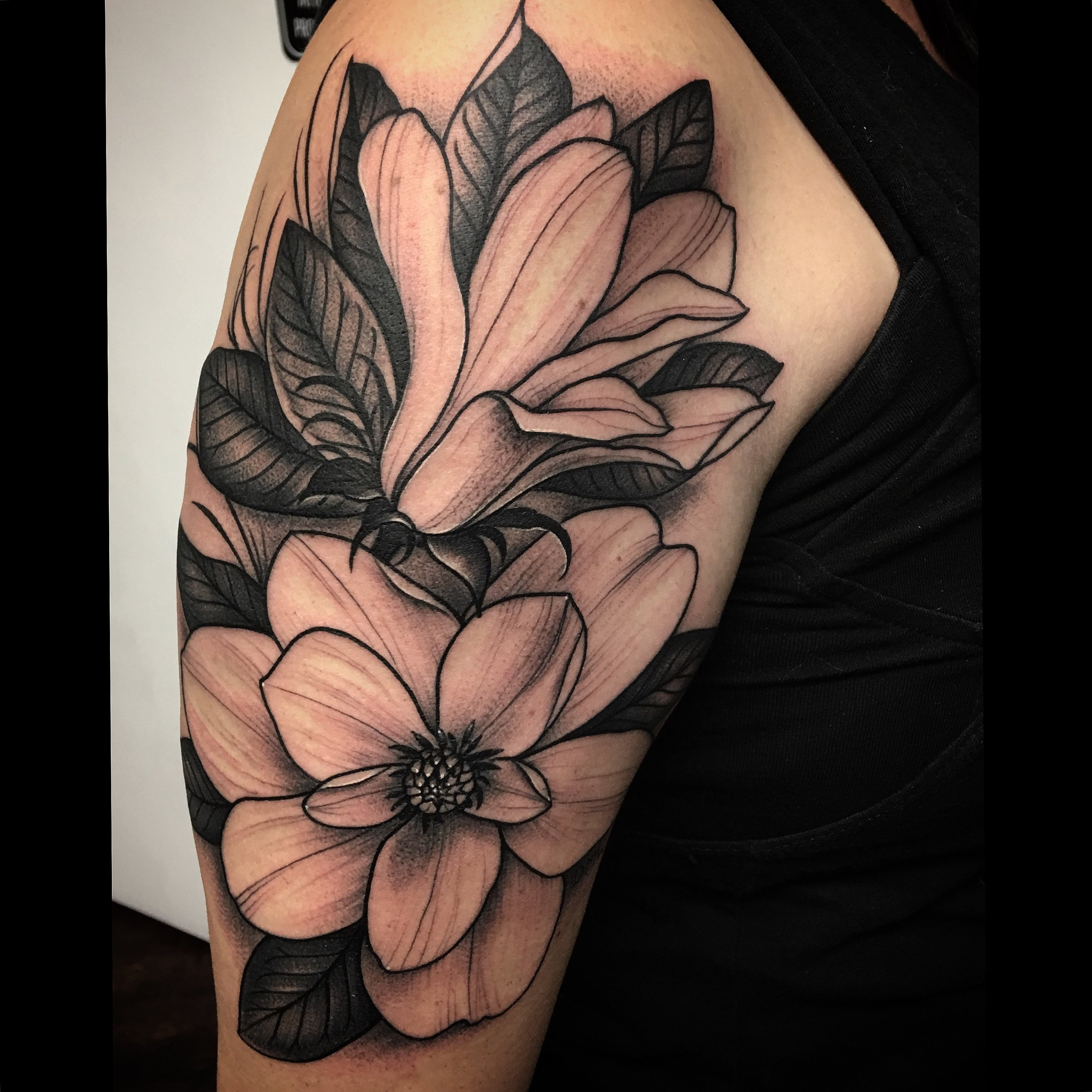 Realistic Black and Grey Magnolia Floral Tattoo by David Mushaney
