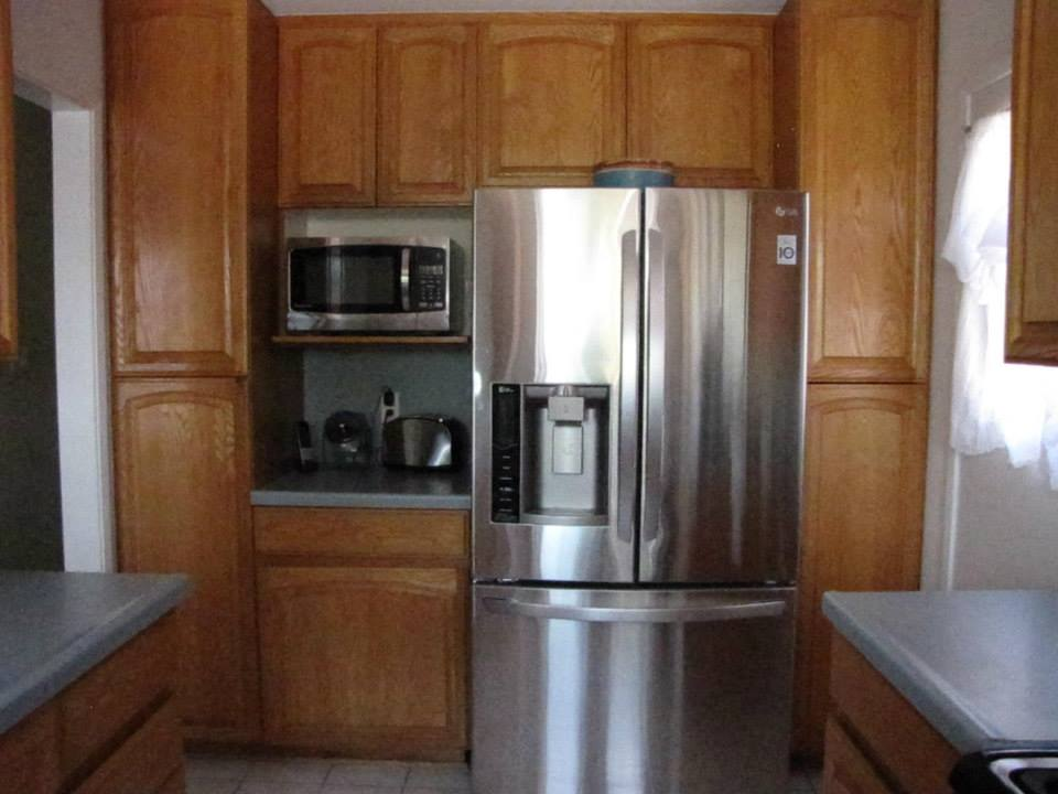 You can see the cupboards and countertops, while not terrible, just look aged.