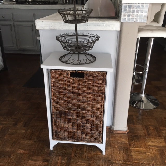 I paid $5.00 for this cute bin that holds potatoes and onions in our kitchen.  The cute fruit stand on top was also a $5.00 purchase!