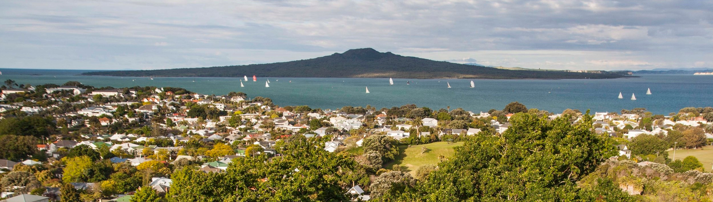 Volcanic and wild Rangitoto Island seen from suburban Auckland, New Zealand