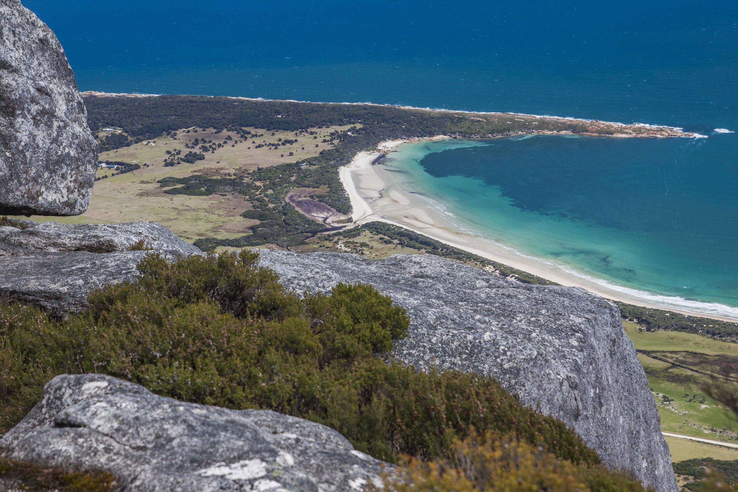 View of Mountain Seas (the most distant cleared area) and the coast from Strzelecki Peak. Trousers Point is hidden by the rock in the upper left.
