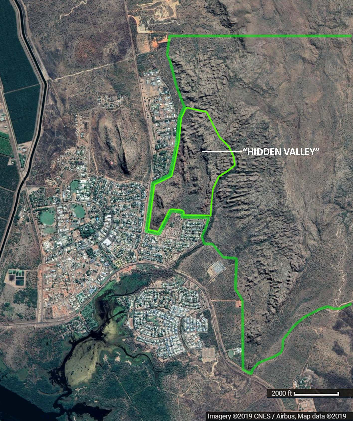 "The town of Kununurra with the western half of Hidden Valley National Park (outlined in dark green), and the accessible portion around the actual ""hidden valley"" (in lighter green) that inspired the  worldview."