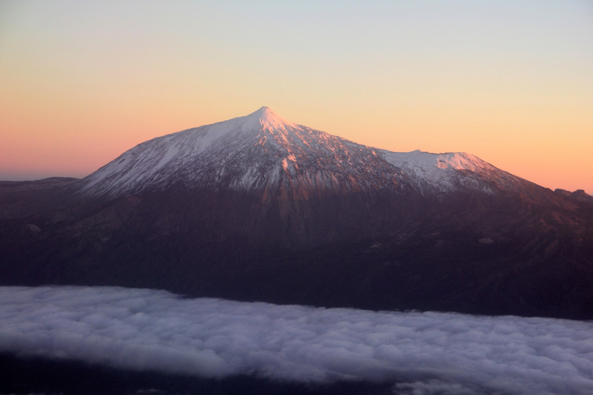 Pico del Teide from the plane at sunset. (My visit to the top came before the snow.)