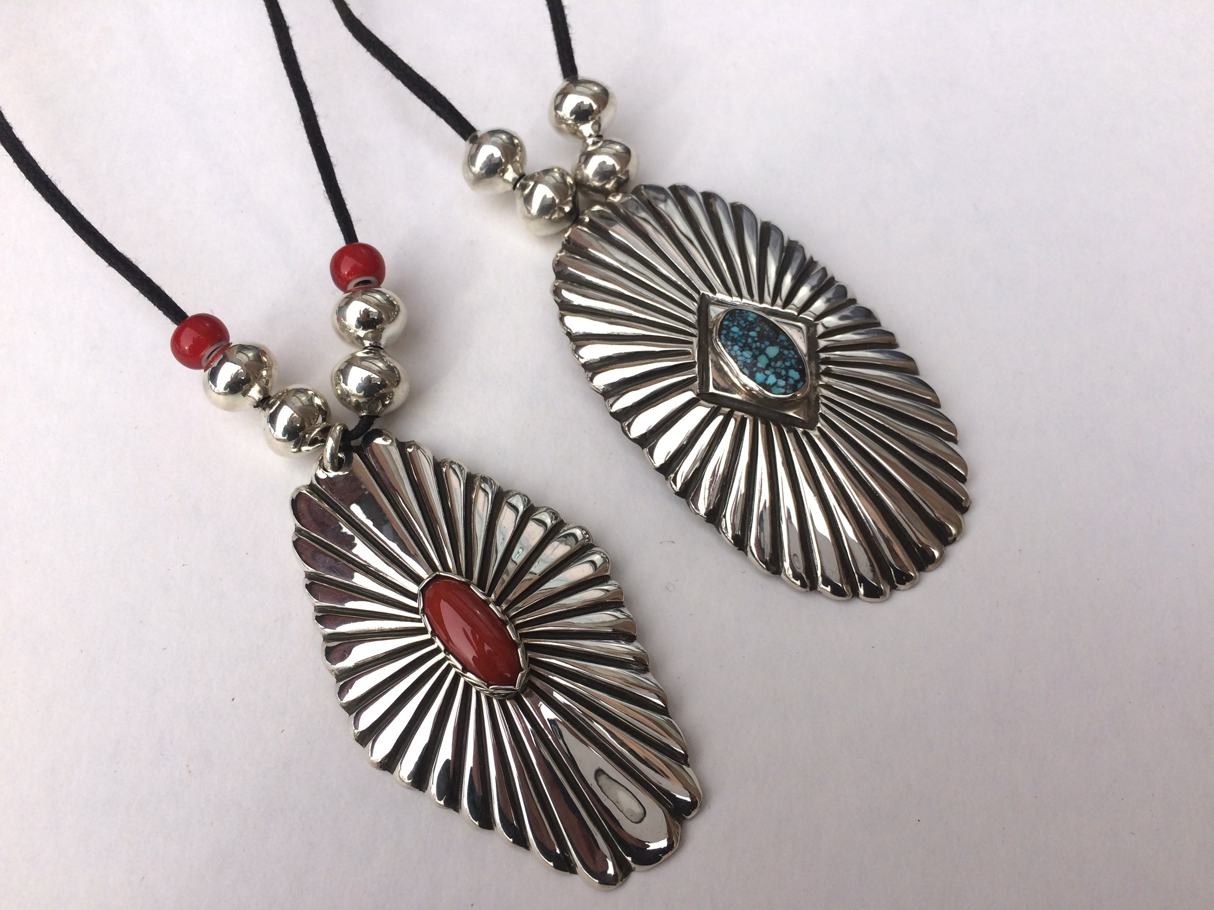 Sunburst pendants with high grade coral and turquoise