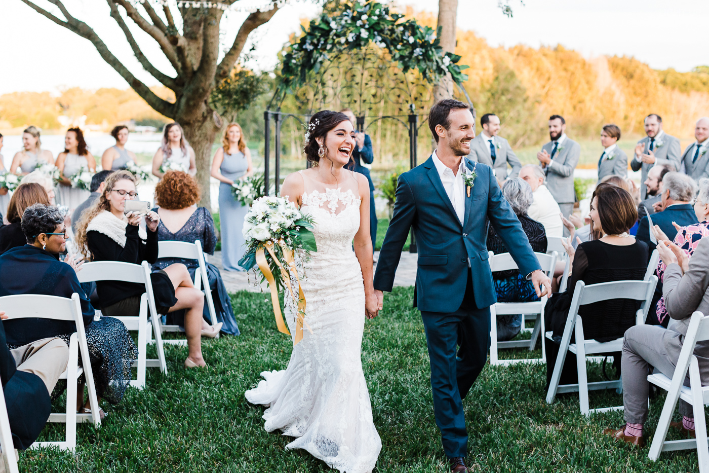 Bride-and-groom-walking-down-the-isle