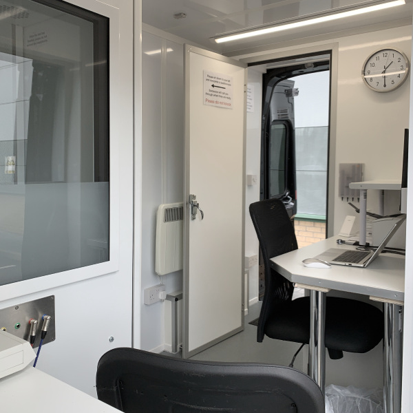 Audiometry booth and door to rear waiting room