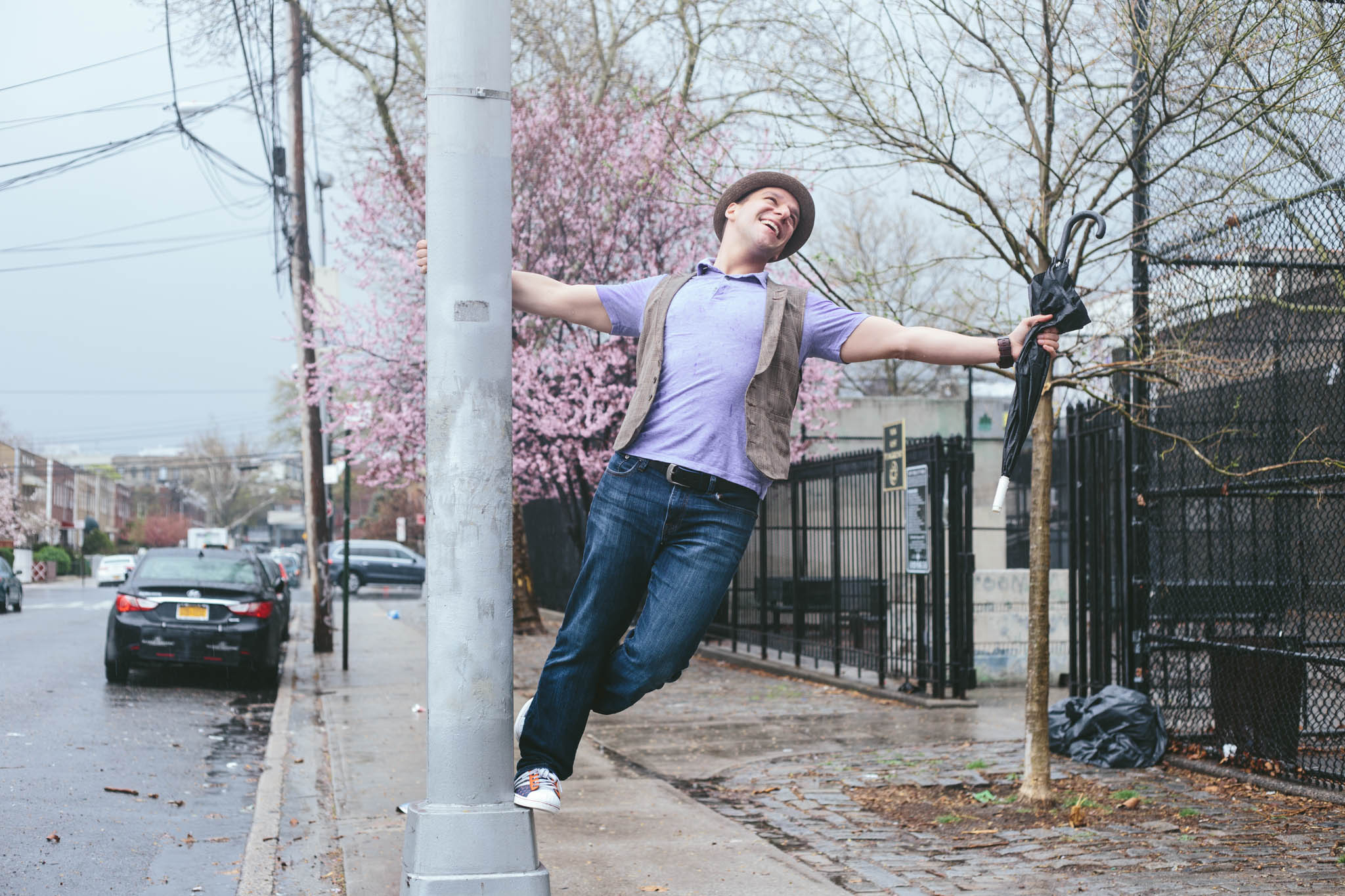 As soon as we finished the interview, it started to rain. We went to Ryan's apartment to grab umbrellas. Of course, we tried to recreate the iconic image of Gene Kelly in  Singin' in the Rain.