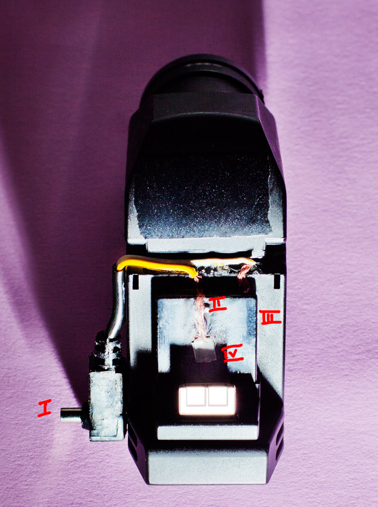 I: recycled P/C socket.  II: the two cables runs along the mount. I simply use the existing contacts from the evf-2. Central and bracket side (III).  IV: To insure a proper connection with the camera hot shoe, fold a thin piece of metal and use as an end of your wire. It should be positionned on the middle of the plate.