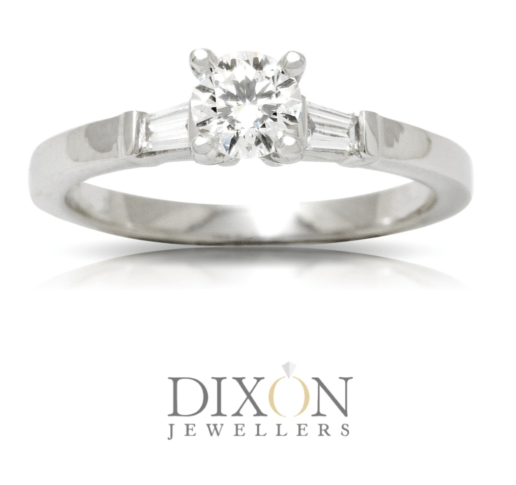 Classic Engagement Ring with a Four-Claw Setting and Baguette Shoulders