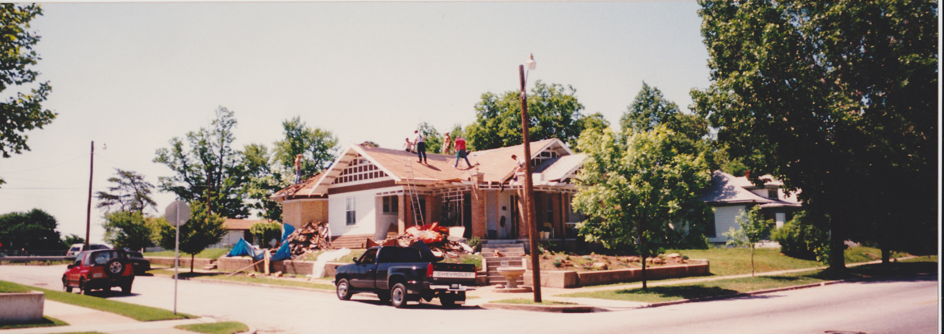 902 N. Denver receiving a new roof by fellow neighbors. (Image by McDaniel Family)