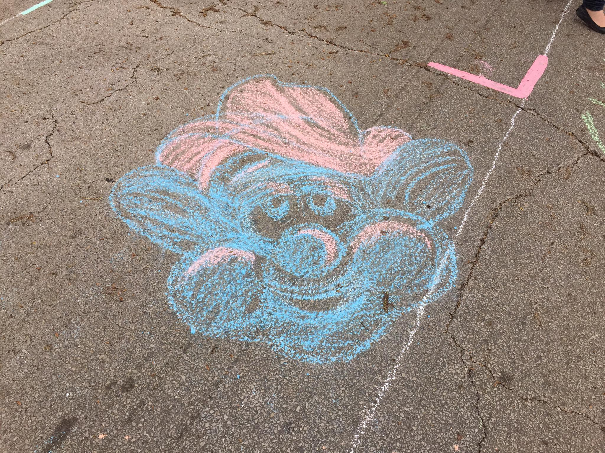 """A cartoon face designed and chalked by Oklahoma House District 73 Representative Regina Goodwin during """"Chalk the Walk"""". (Photo © 2017 Brian Parker)"""