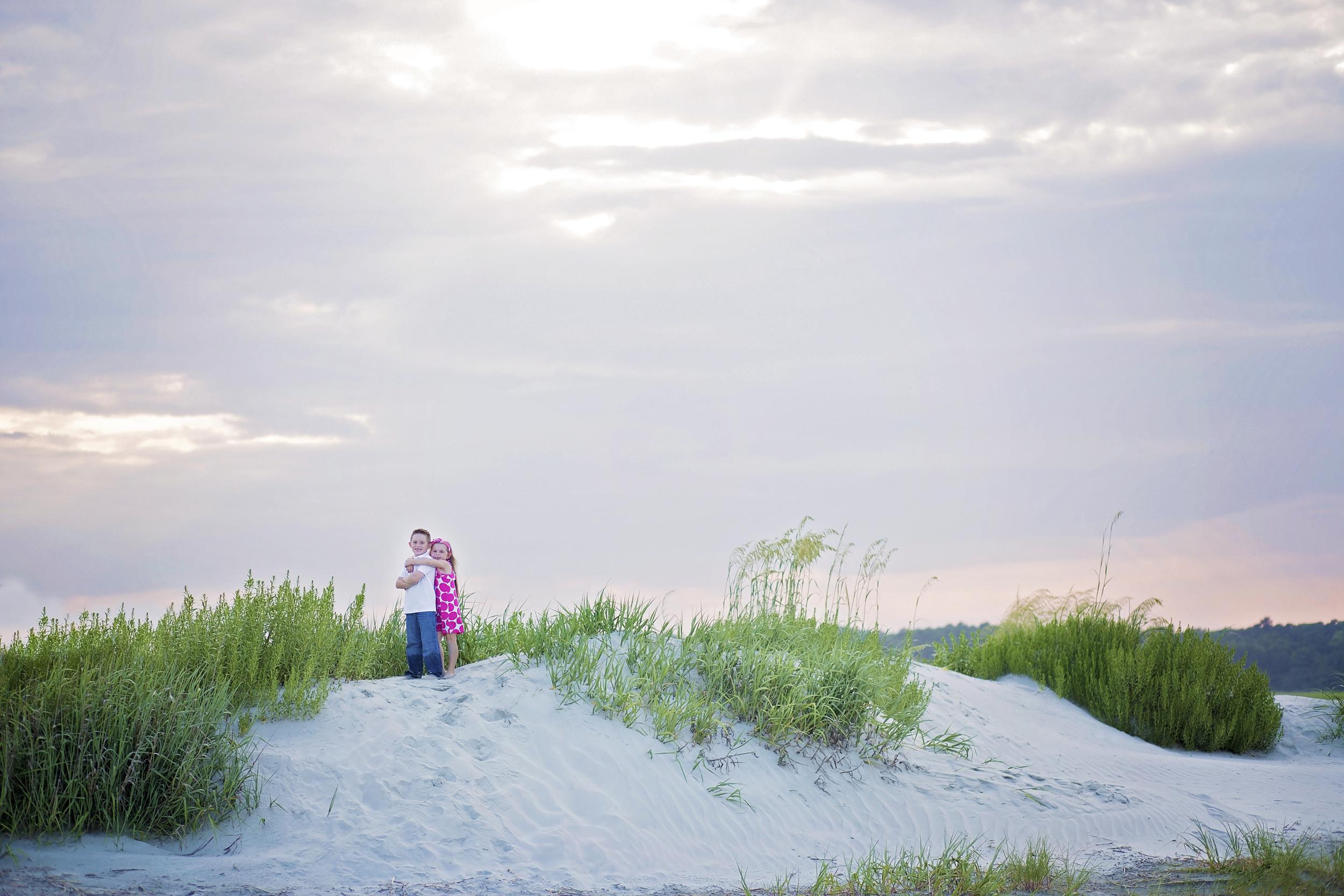 children on dunes in cherry grove beach sc family photographer
