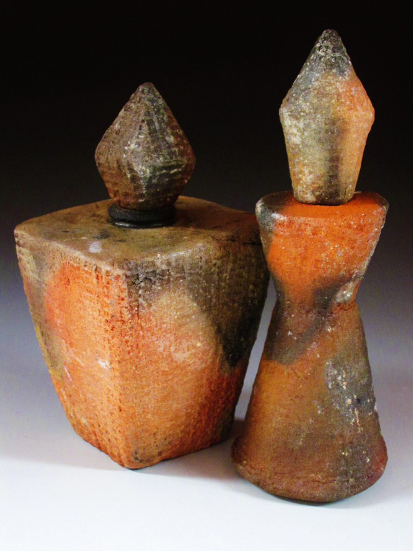 Two perfume Bottles  7x2.5x2.5  Hand built form locally dug clay  $80 each.jpg