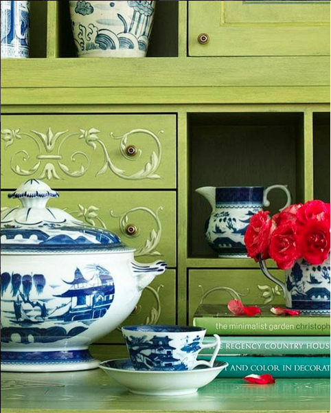 The blue and white china with red flowers against a green cabinet is stunning. (Image from:  Traditional Home )