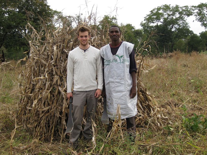 Austen and I infront of a maize pile ready for harvest