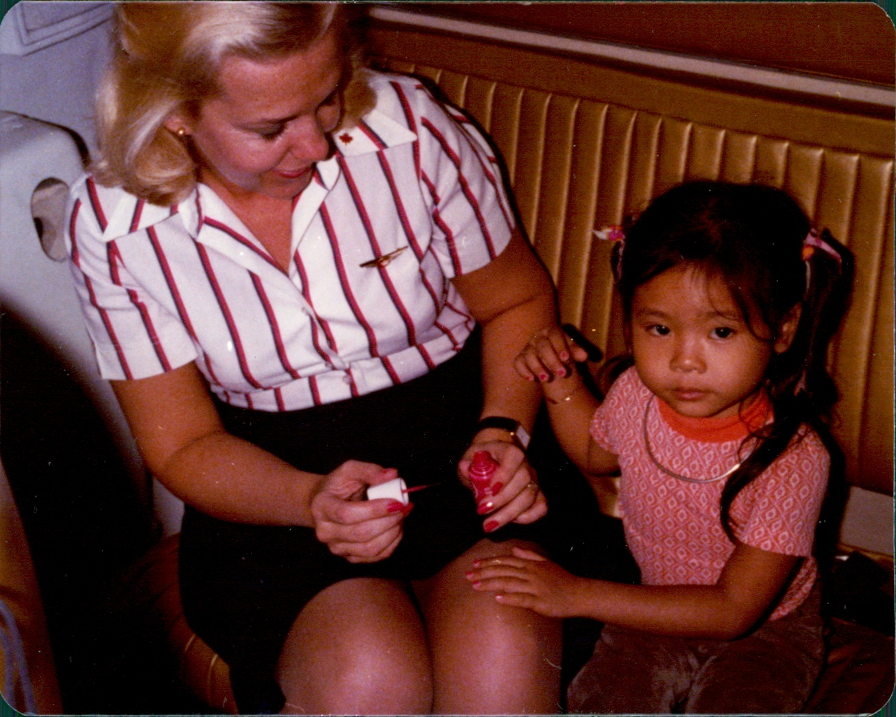 Lillian (Marsh) Wright painting nails with little girl.