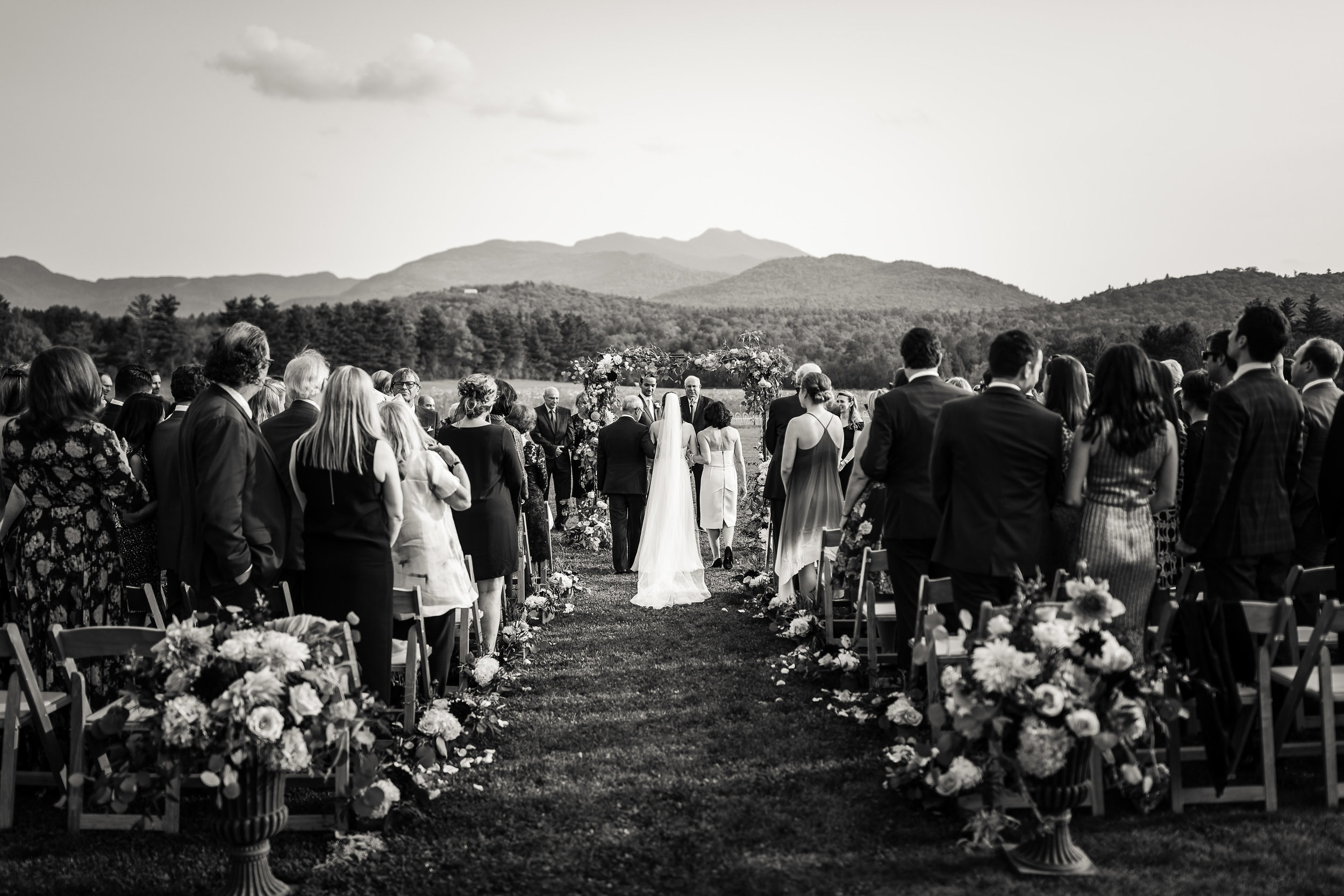 A stunning bride, stunning ceremony and stunning backdrop at The Barn at Smugglers' Notch. The perfect location for your Stowe Wedding. Image:  Jag Studios