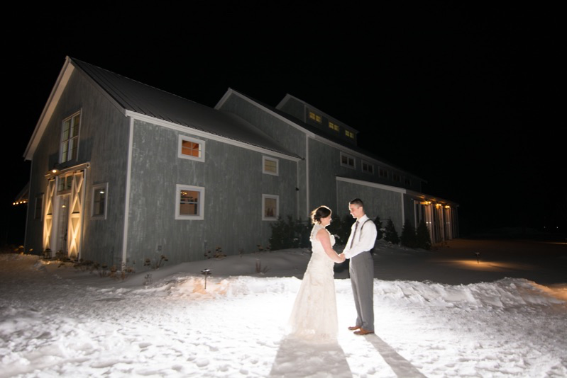 One of our Winter Stowe Wedding Couples outside The Barn at night.