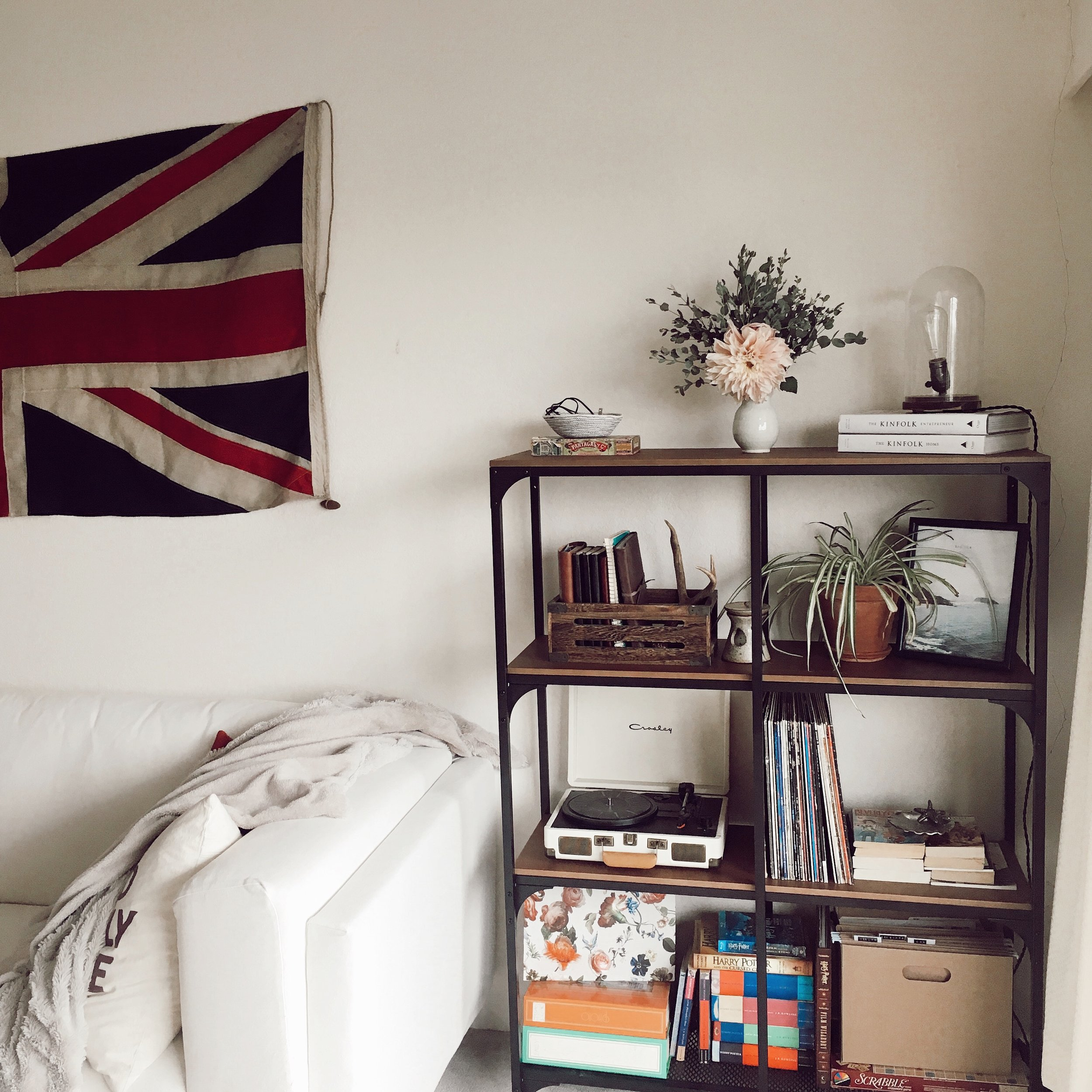 Cashmere & Plaid | lifestyle blog in Victoria BC - cozy living room featuring vintage union jack flag, industrial shelving, flowers, and DIY Ikea hack lamp