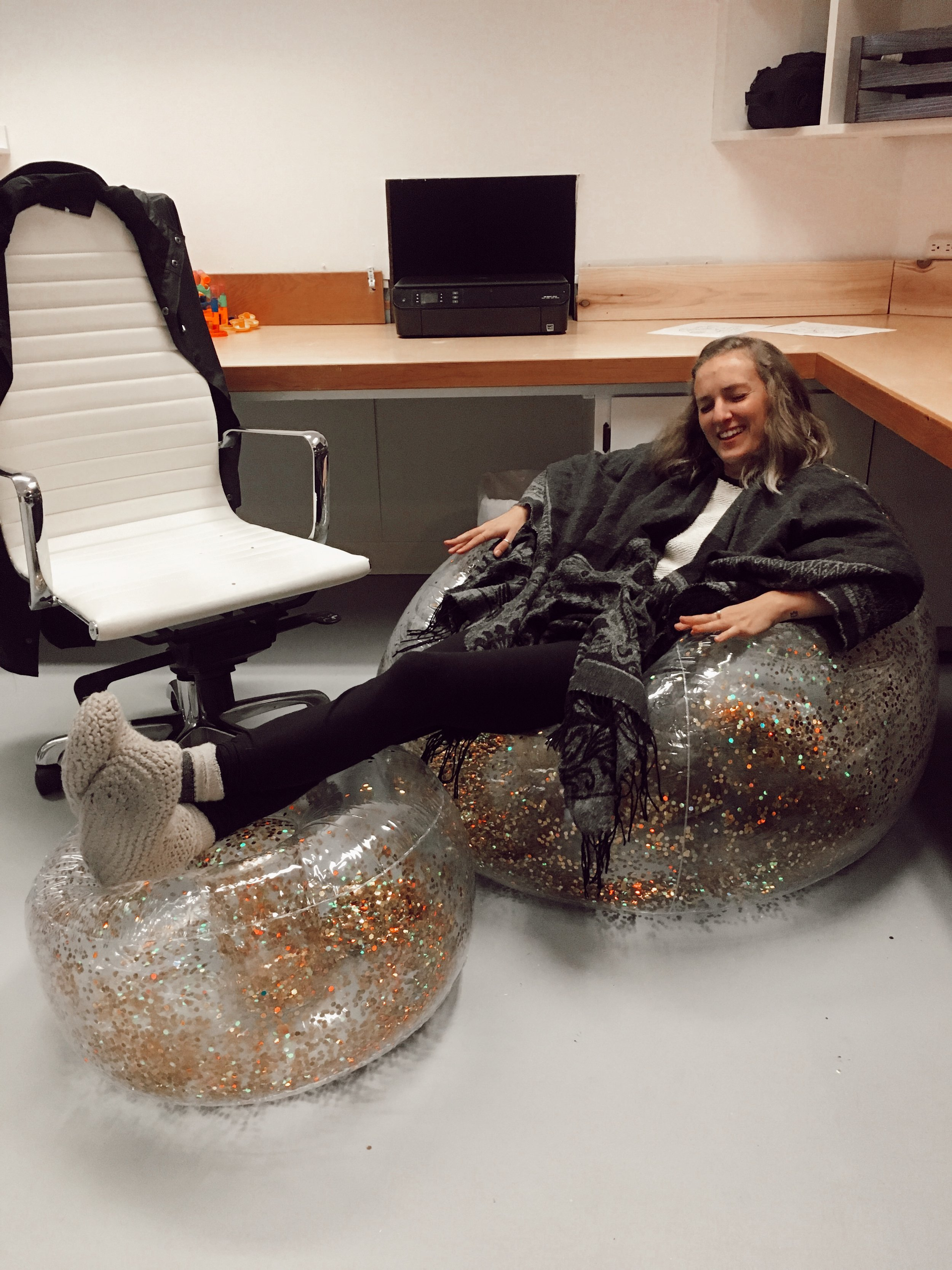 Cashmere & Plaid | lounging at work in inflatable glitter chairs
