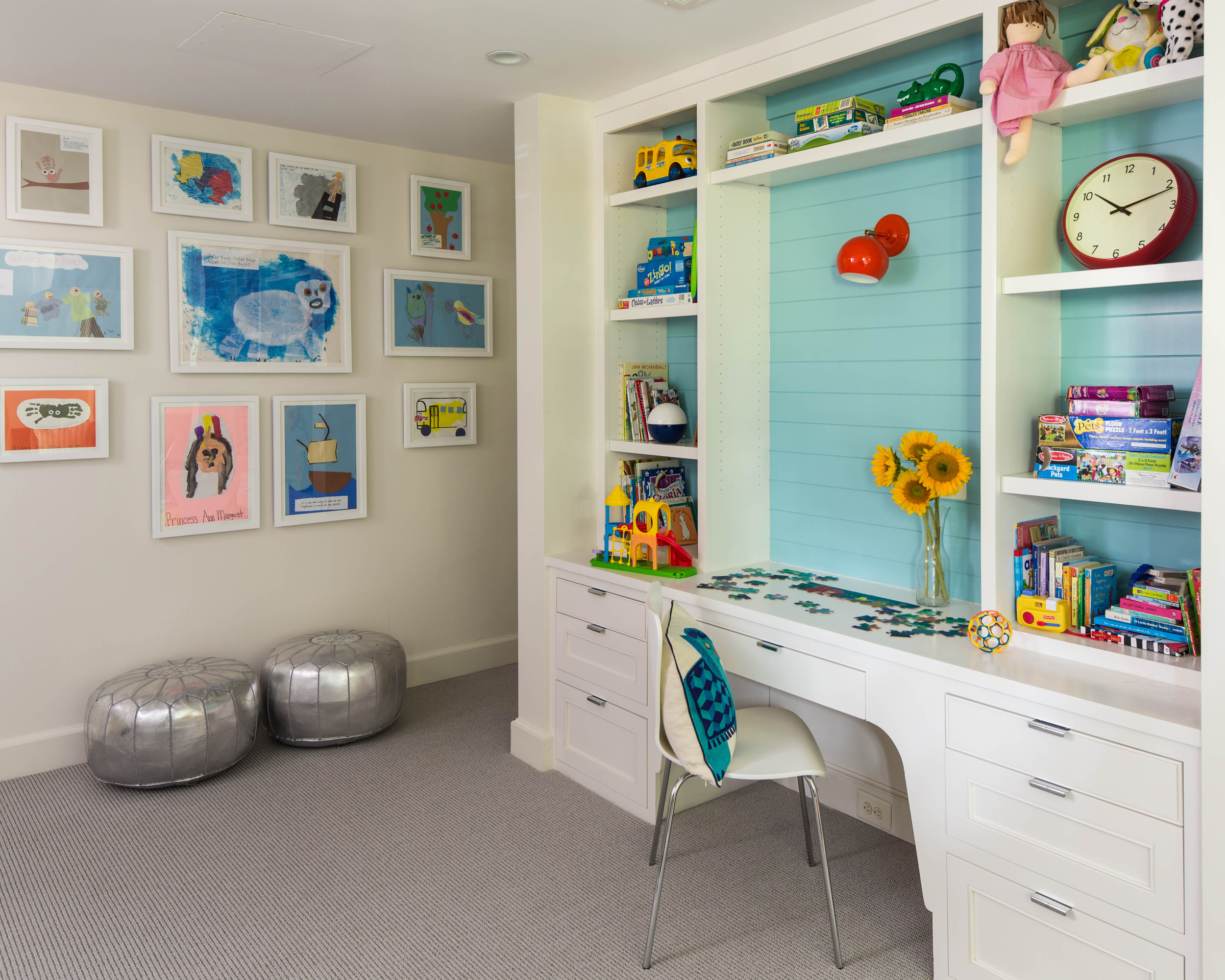 Playroom with durable carpeting, built-ins, and plenty of run around space.