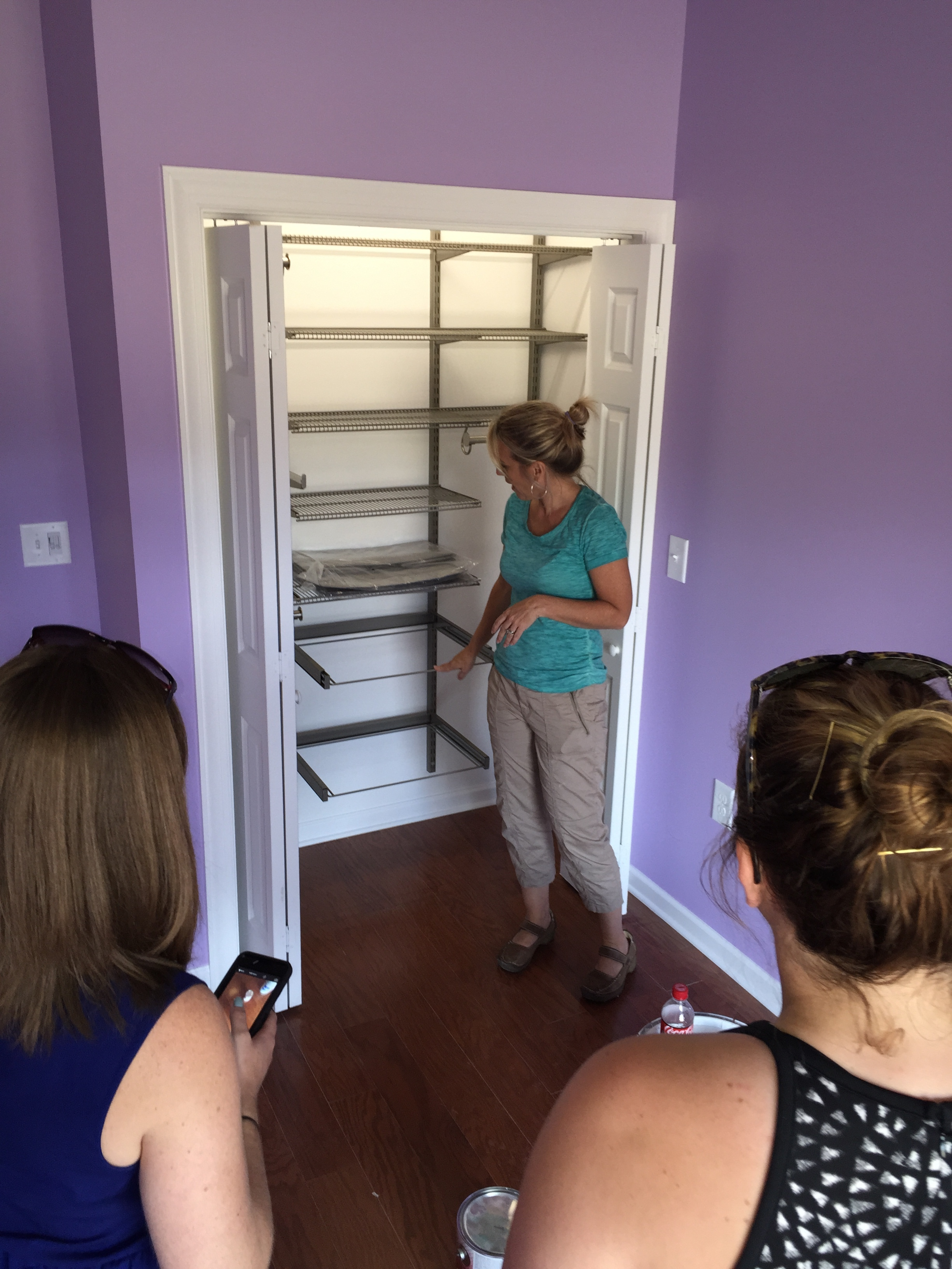 Kim McBrayer, owner of spacecadetsorganizing.com, demonstrating one of many of the closet systems she donated to the hfotusa.org in Calera, AL.