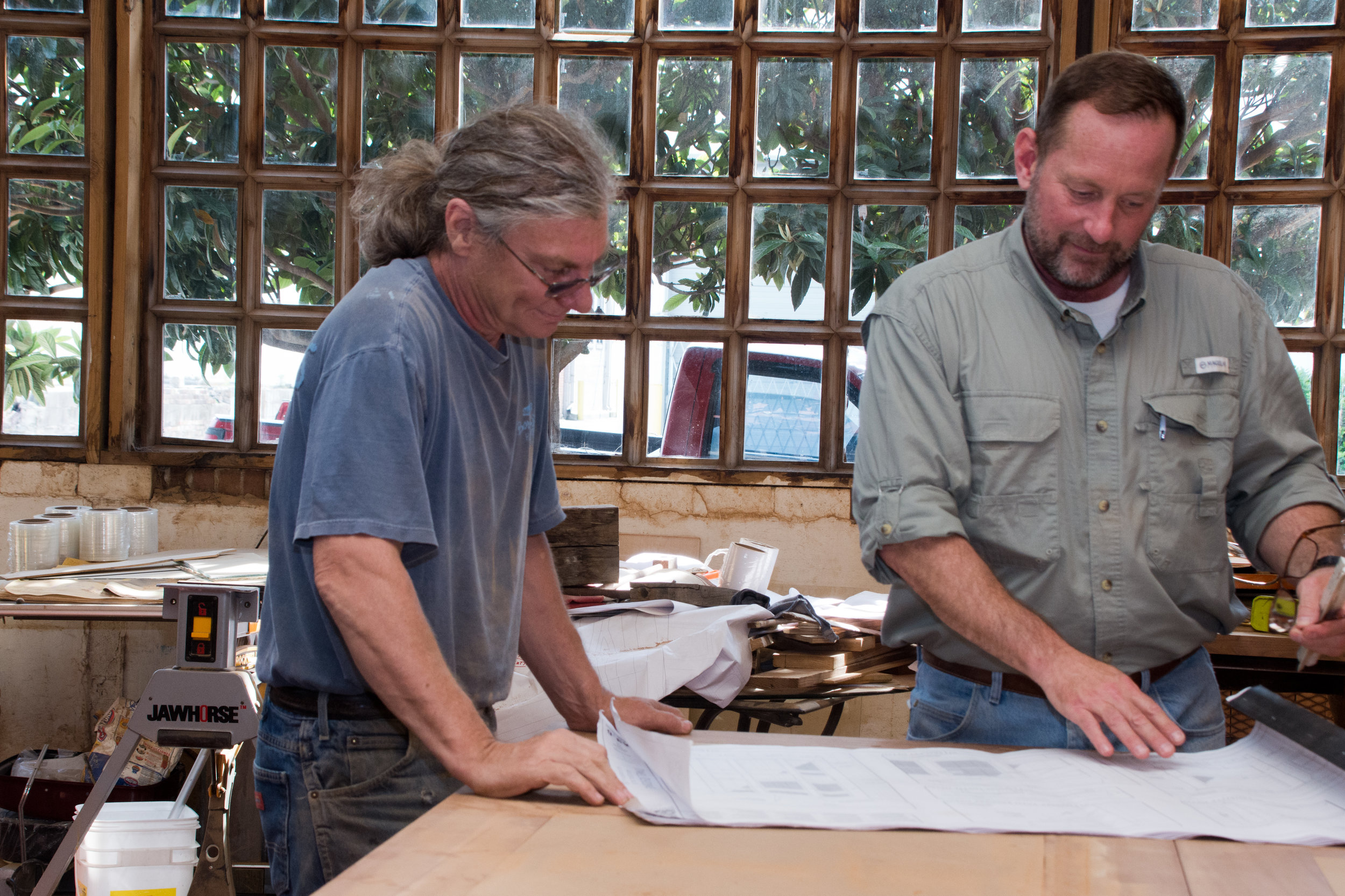 Sleeves rolled up doing what we love to do. Jim Miller (L) and Steve Ray (R) looking over details for exotic beams and brackets.