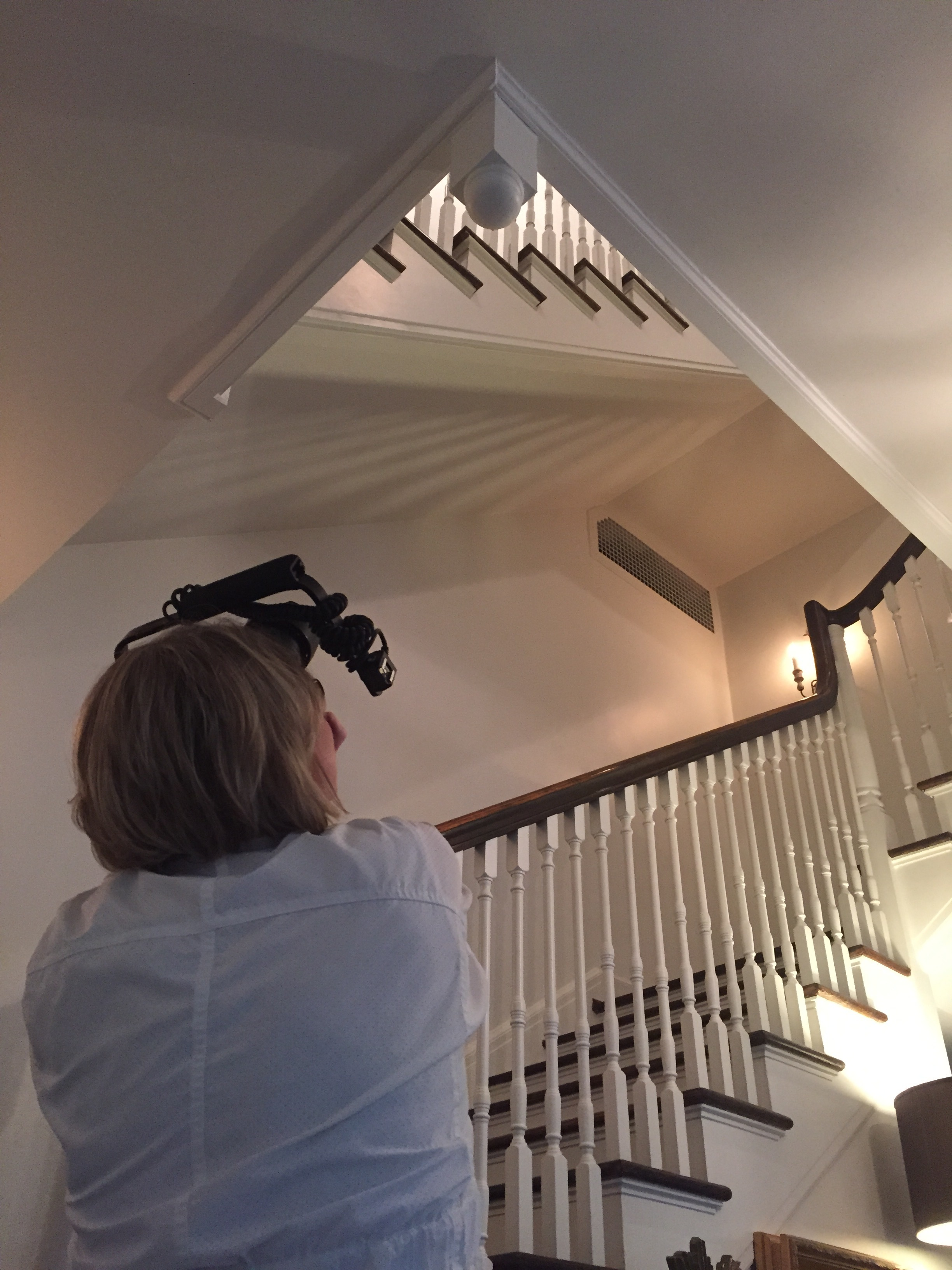 Friend and professional photographer, Catherine Pittman Smith, shooting a Surrey Road three story spiral staircase.