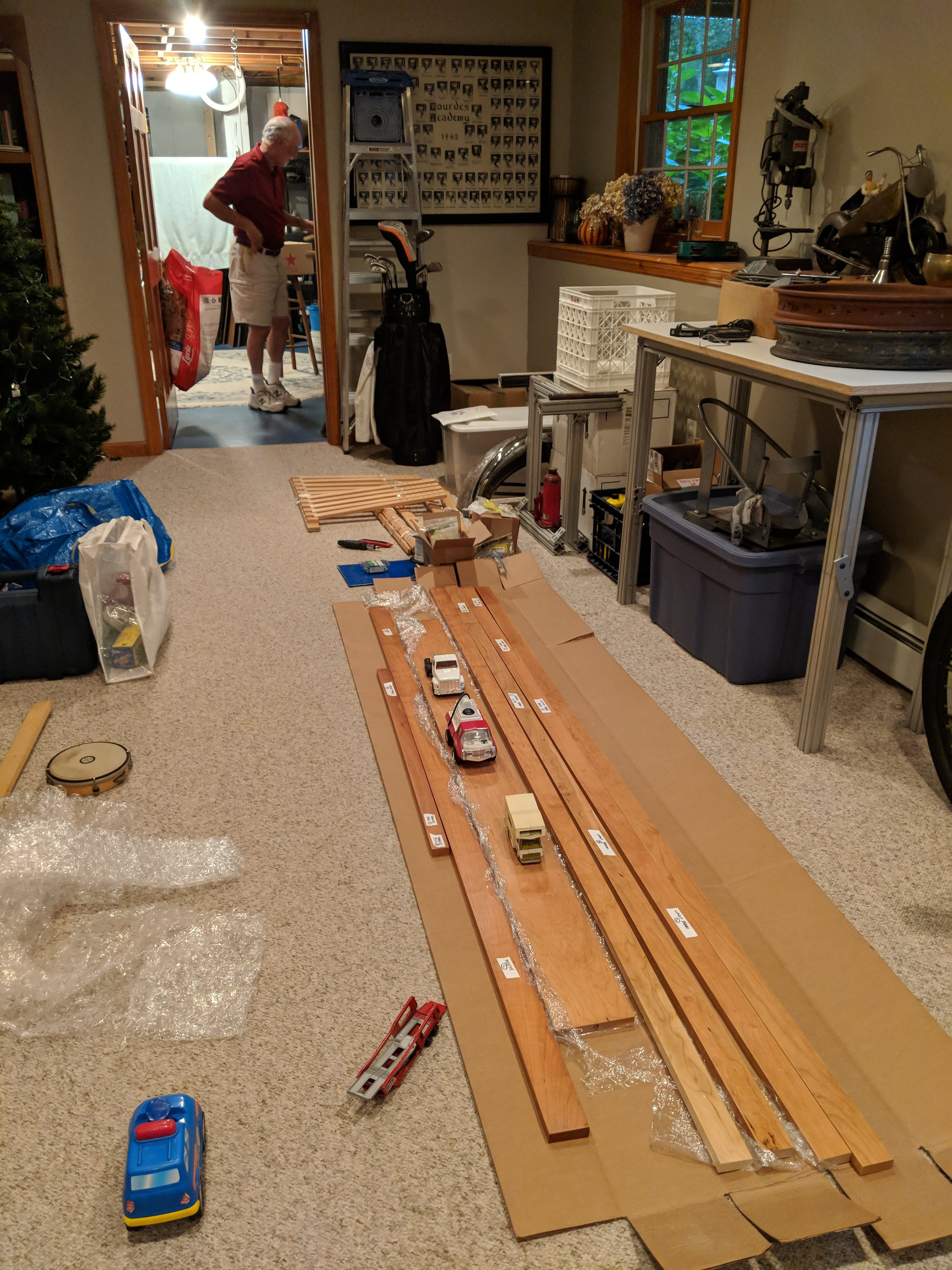 Wood is ready to be cut. That's my pops in the background helping.
