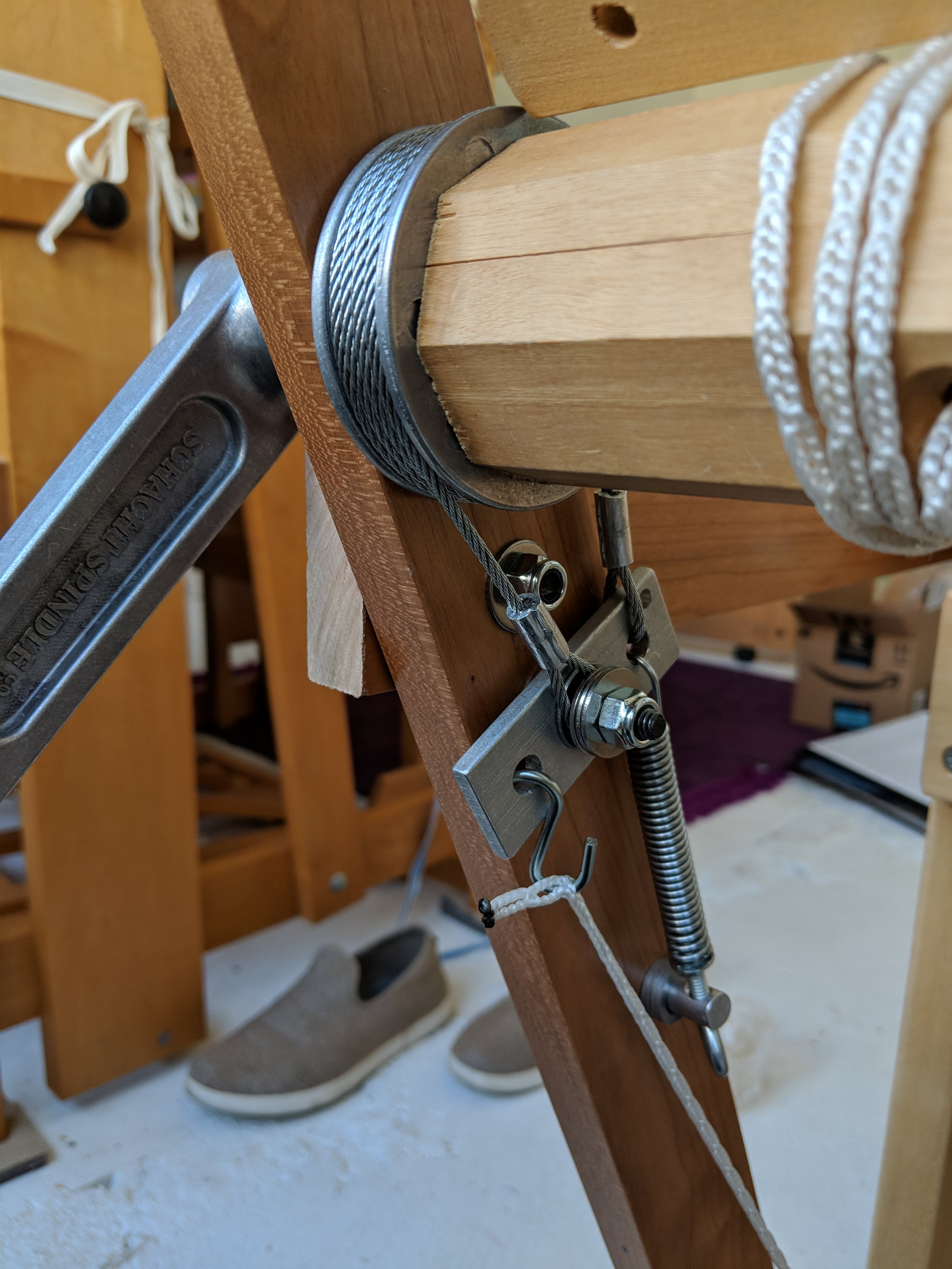 Oh, brake. Look at you! So beautiful! Working so well! I had help from a friend (THANK YOU DAN) to get a hole drilled through the center of the bracket. I used the drum brake from the Schact Mighty Wolf, but had to alter the configuration a bit due to the geometry of my loom.