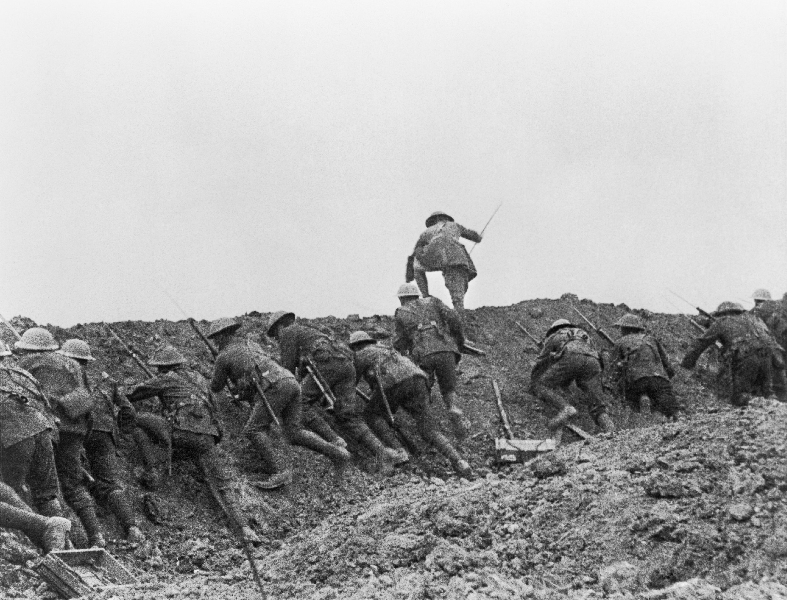 Staged scene from    The Battle of the Somme    film, 1916   British troops go 'over the top' into 'No Man's Land'. This   scene was staged for the camera at a training school behind the lines.  © IWM (Q 70164)