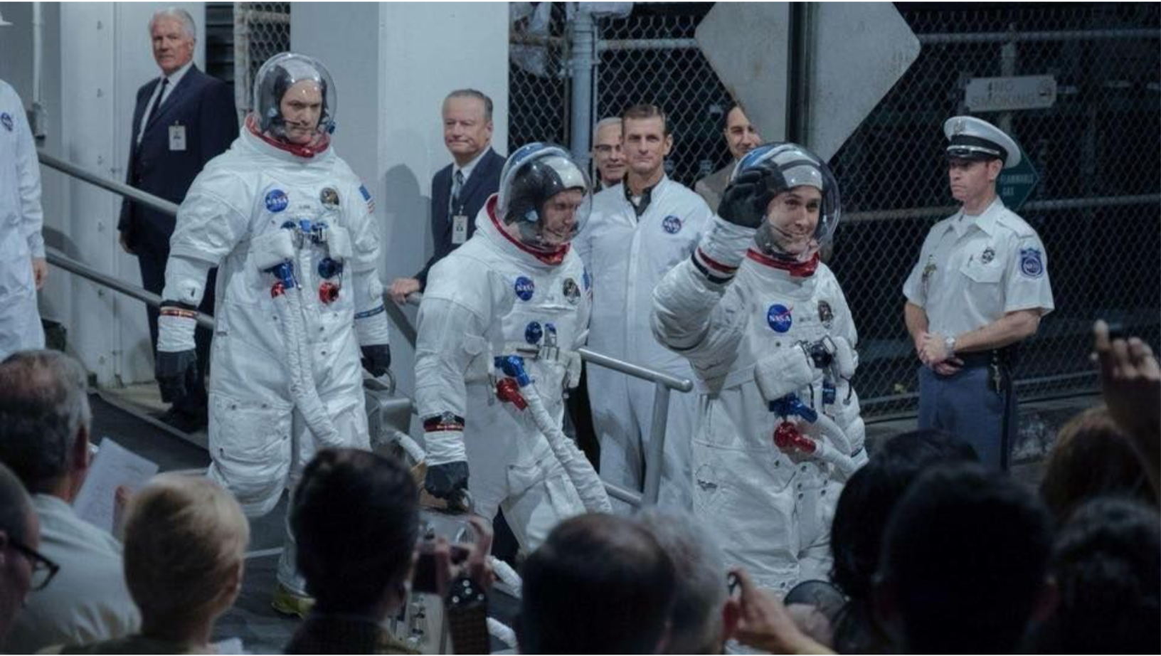 Dr. James R. Hansen can be seen dressed in a suit, standing beside a pillar to the left of centre.    First Man  (2018)