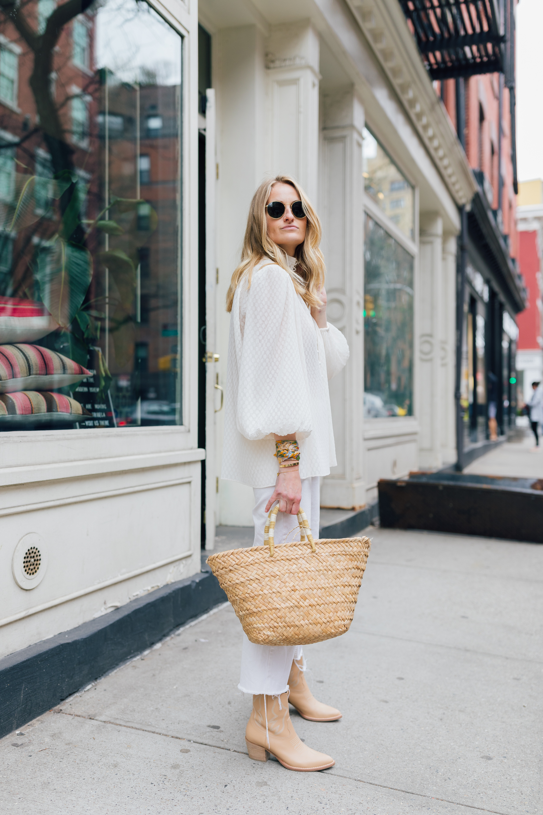 Spring street style in New York Stephanie Trotta in a Zimmermann top with Mango jeans and a straw bag The Girl Guide