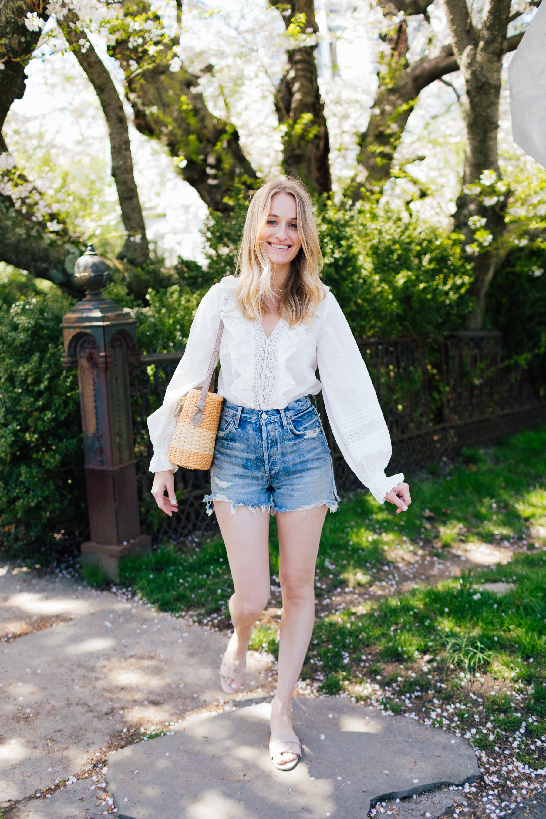Stephanie Trotta from The Girl Guide in Agolde Shorts and an H&M blouse
