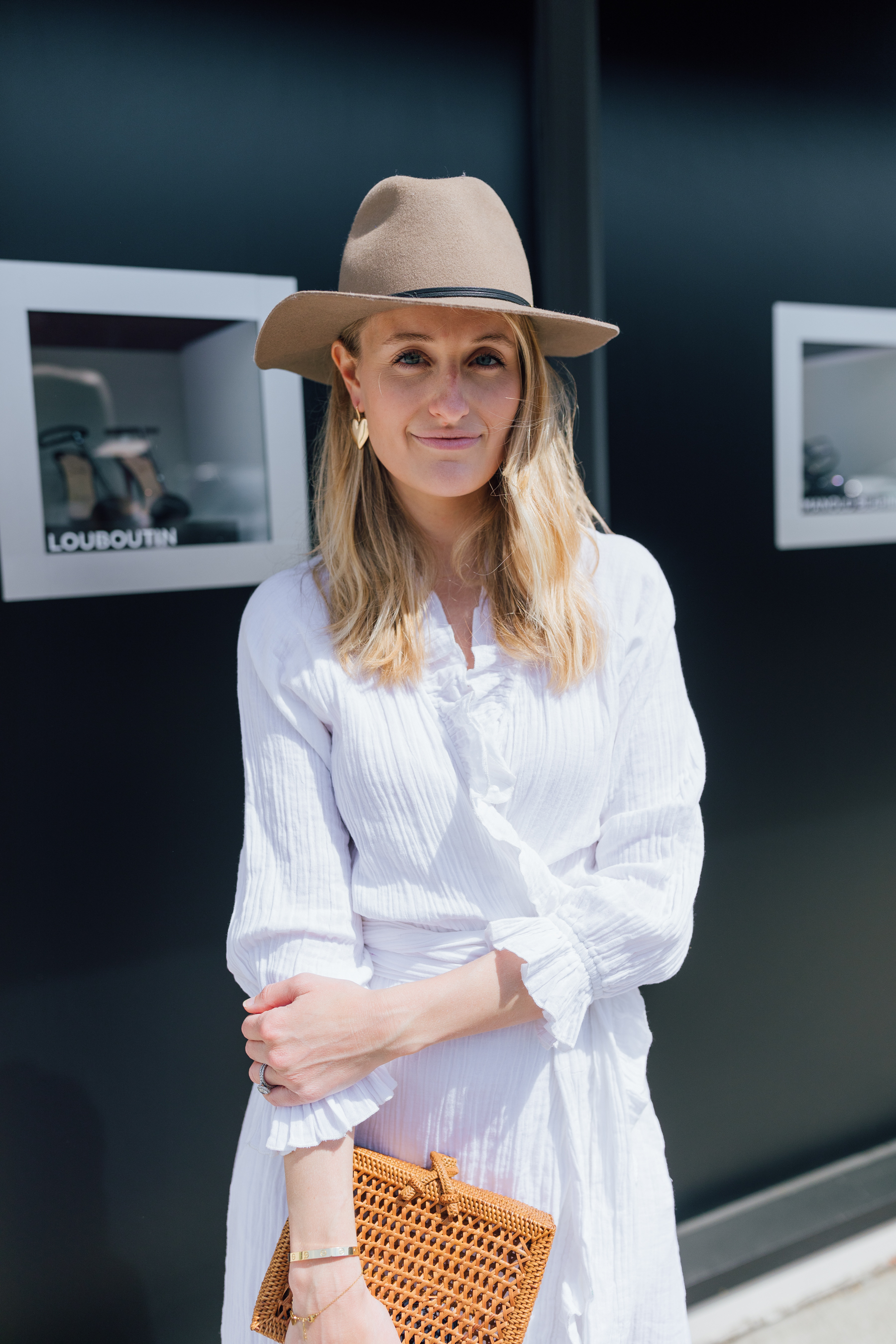 Stephanie Trotta from The Girl Guide in Rhode Resort Dress // How to style a hat for summer // White dress for summer
