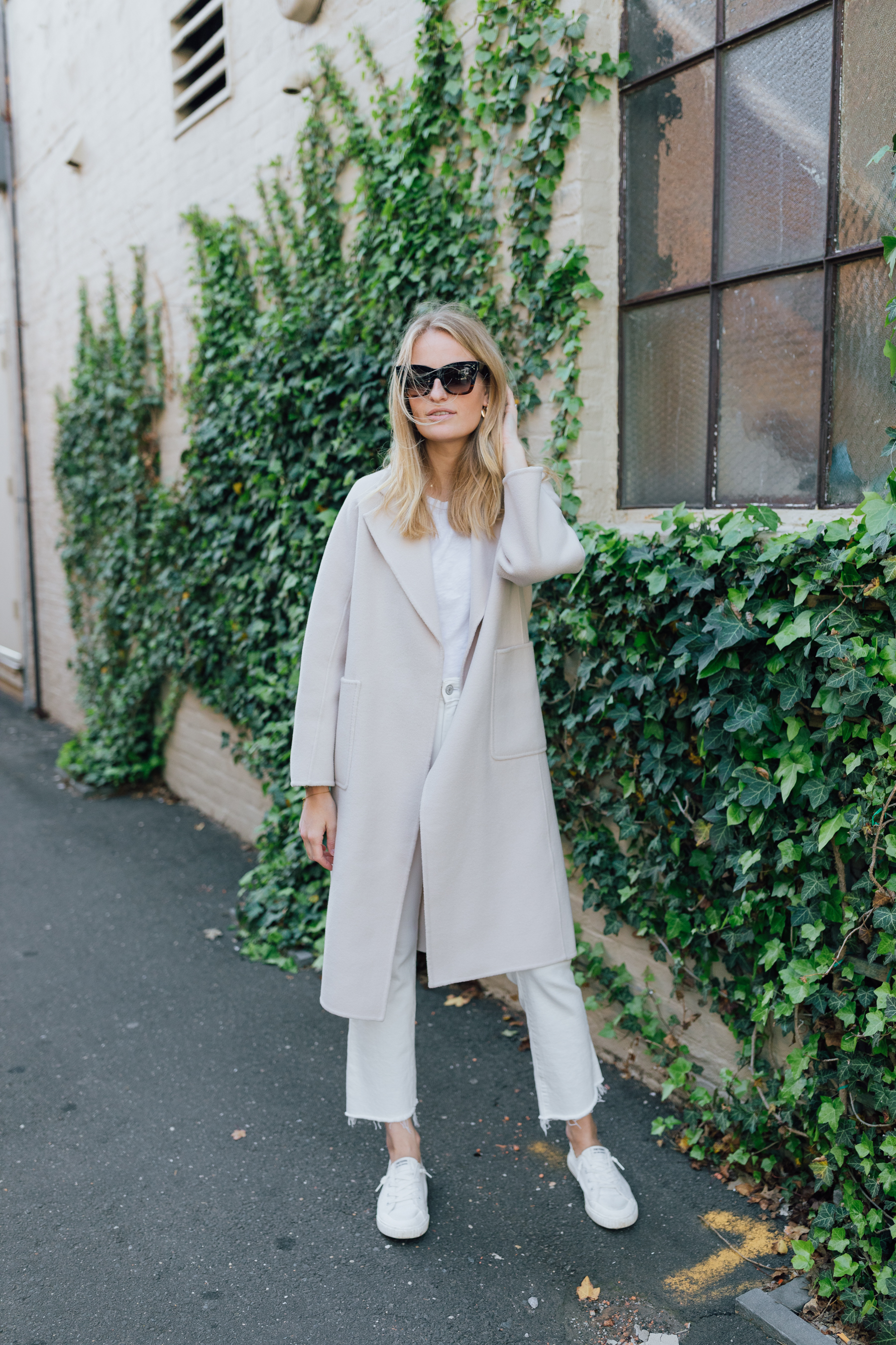Neutral outfit for Spring and Fall // Oversized coat from The Curated styled with sneakers // The Girl Guide // Stephanie Trotta