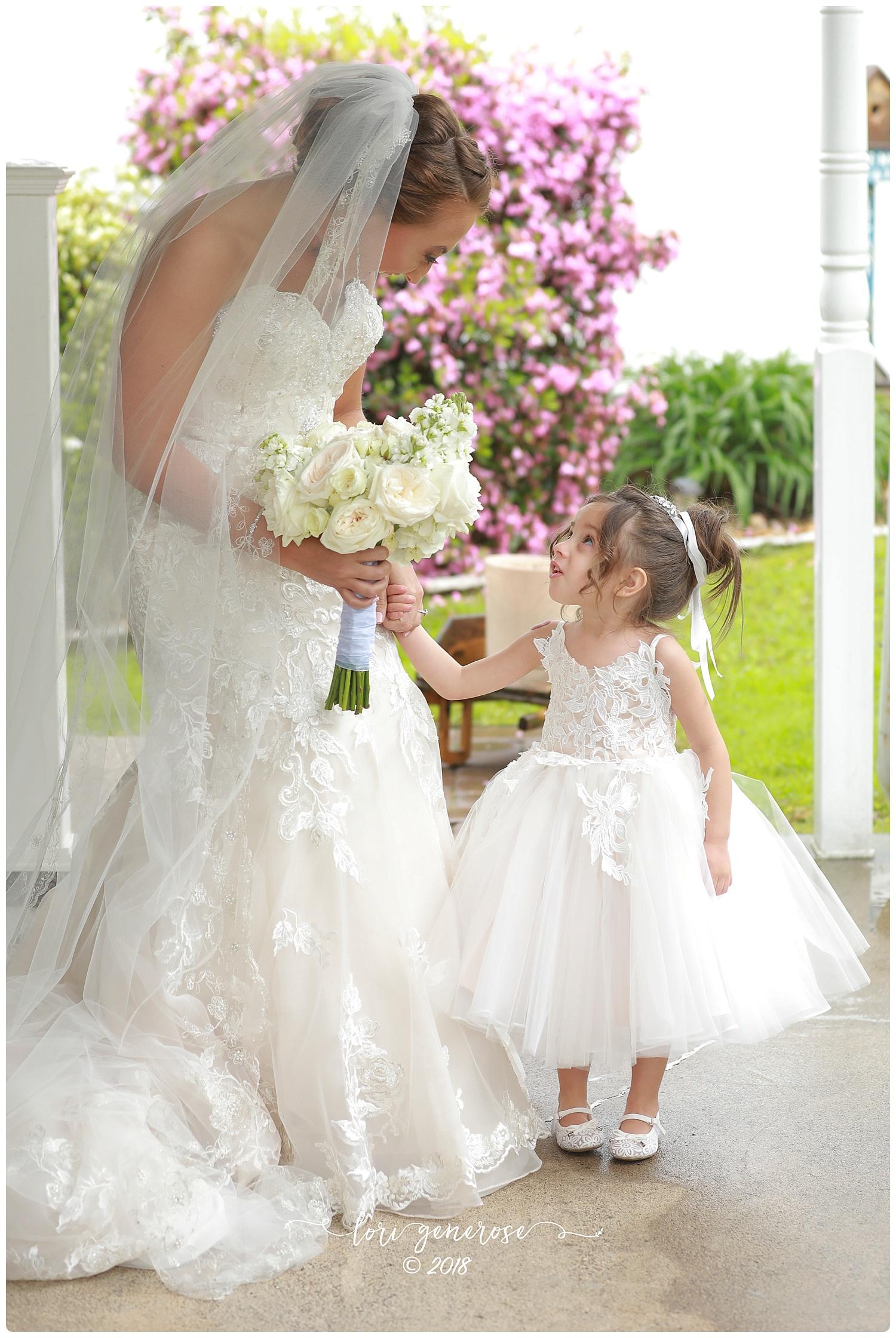 lgphotographylorigeneroseweddingbrideandflowergirldressweddingdress.jpg