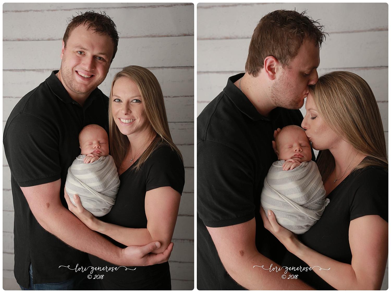lgphotographylorigenerosenewbornfamilystudiosessionnewbornboyswaddledwithmomanddadfamilypose.jpg